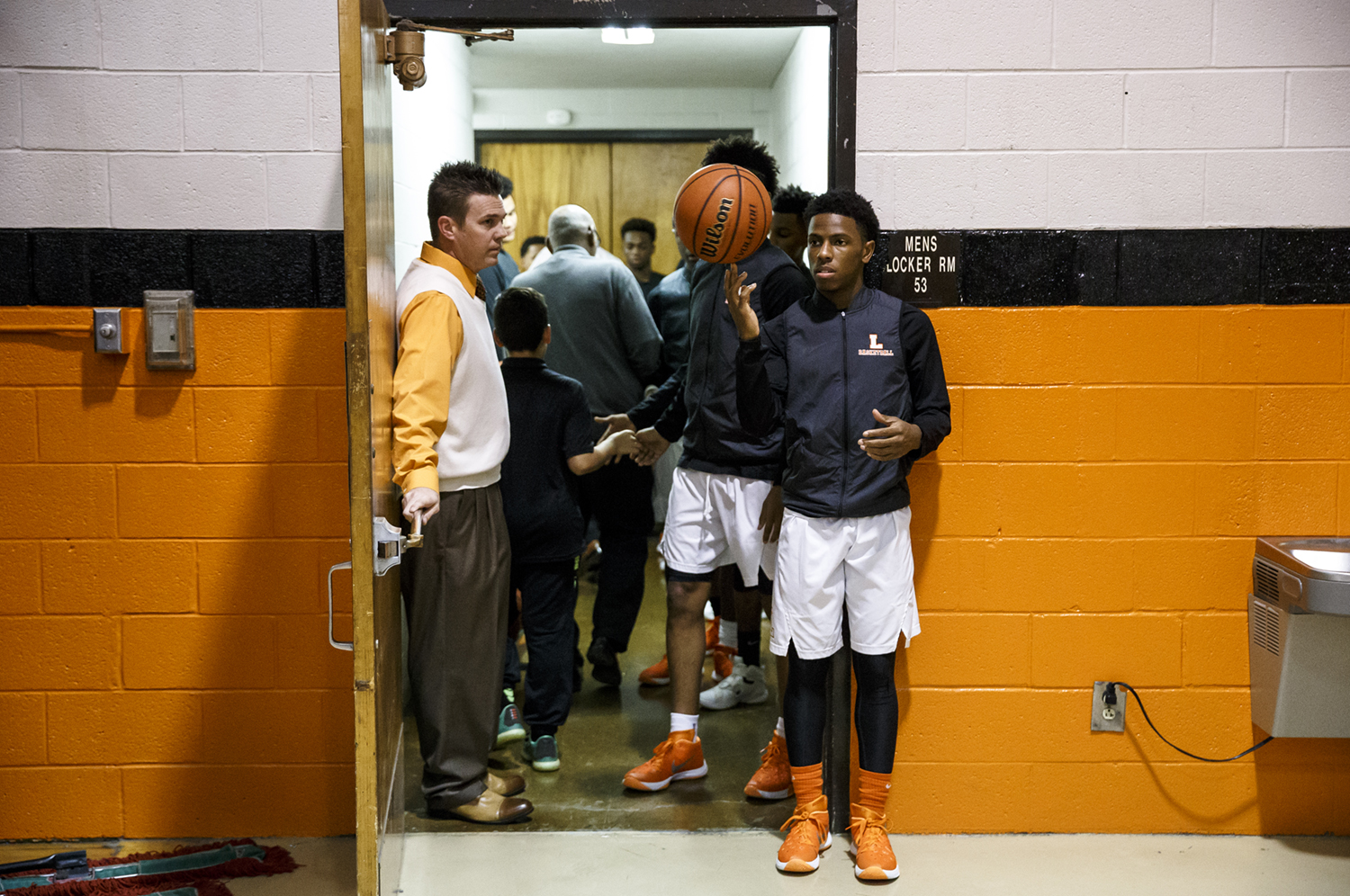 Lanphier's Xavier Bishop (5) waits outside the locker room as the Lions prepare to take the floor to take on Jacksonville at Lober-Nika Gymnasium, Friday, Dec. 11, 2015, in Springfield, Ill. Justin L. Fowler/The State Journal-Register