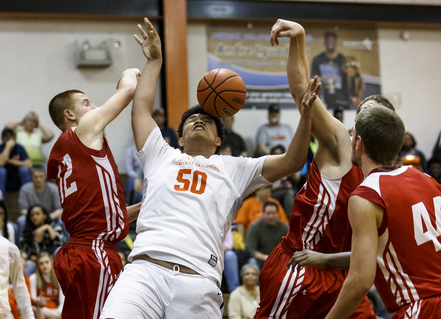 Lanphier's William Boles (50) draws the foul from Jacksonville's Brandon McCombs (12) as he went up for a shot in the second half at Lober-Nika Gymnasium, Friday, Dec. 11, 2015, in Springfield, Ill. Justin L. Fowler/The State Journal-Register