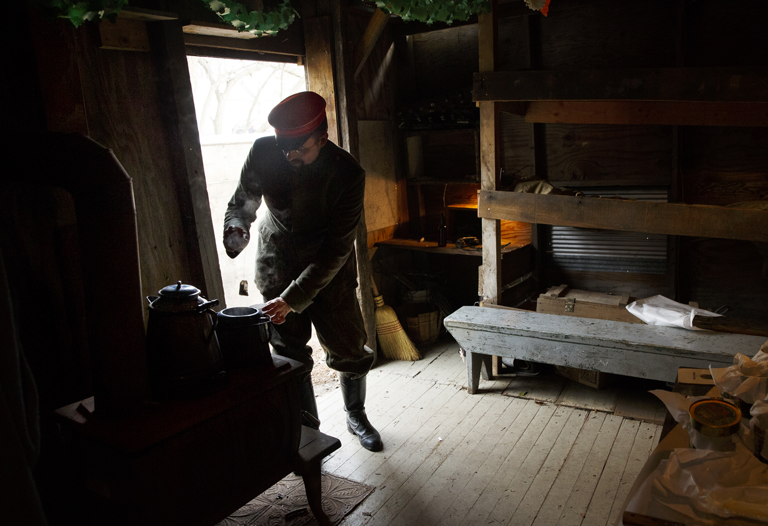 Erik Hack prepares a cup of tea near the entrance to a nine person bunker on the grounds of the Illinois State Military Museum during the Christmas on the Front program Saturday, Dec. 12, 2015. Hack was one of many historical re-enactors from the Revolutionary War, the Civil War, World War I and World War II. They talked to visitors about their equipment and how the soldiers handled being away from home during the holidays. Ted Schurter/The State Journal-Register