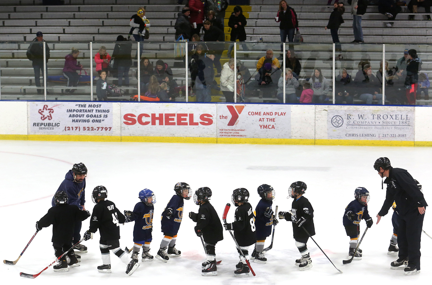 Sportsmanship is always emphasized at the youth hockey level. Members of a Springfield Kings Mini-Mite team shake hands with players from aTwin Bridges Lighting team based in Granite City, Ill on Saturday. With interest locally for the Springfield Jr. Blues hockey team and on the national stage, the success of the Stanley Cup winning Chicago Blackhawks,  area youth hockey programs are booming. That interest was on display at the Nelson Center in Springfield when The Springfield Youth Hockey Association held a Youth Hockey Jamboree featuring 18 Central Illinois teams competing in games in the Mite (eight and under) and Mini-Mite (six and under) divisions. David Spencer/The State Journal-Register