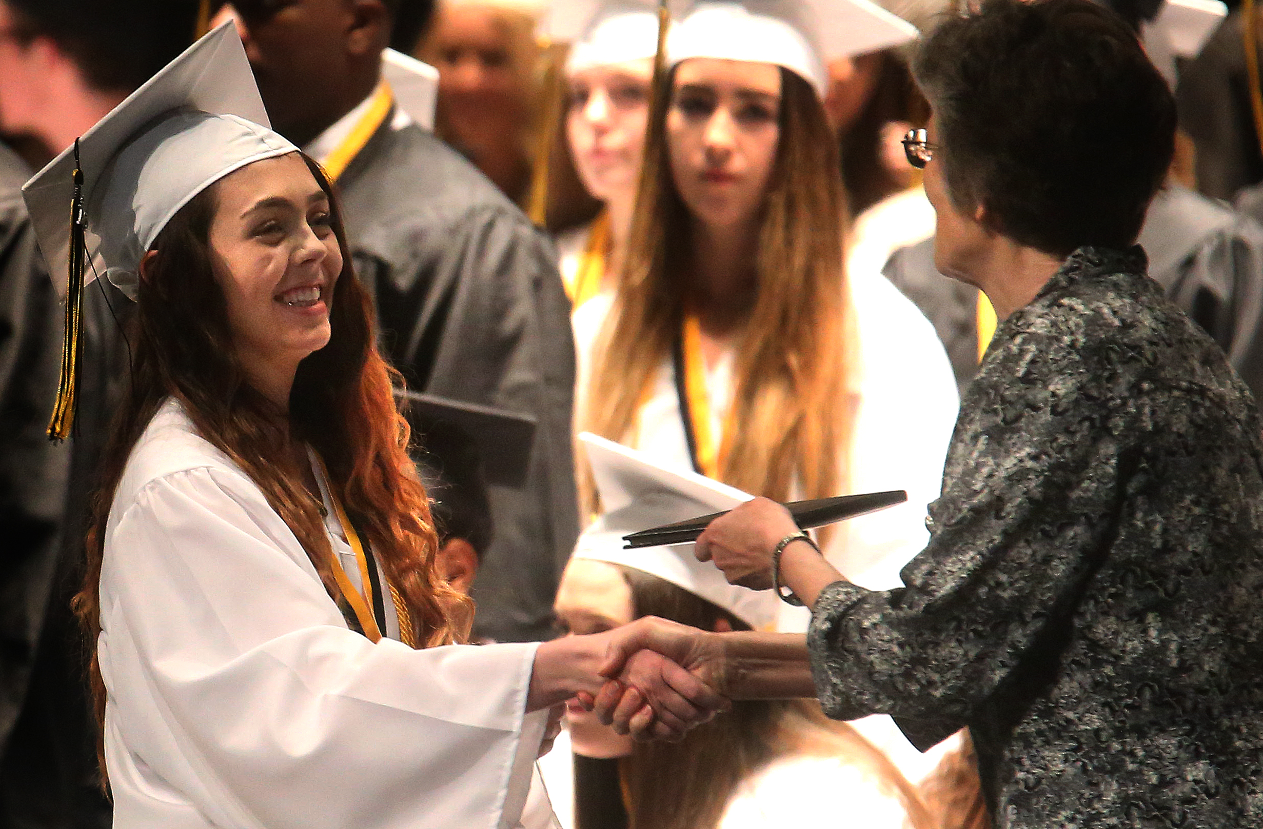Victoria Londrigan receives her diploma from school principal Sister Margaret Grueter on Sunday. David Spencer/The State Journal-Register