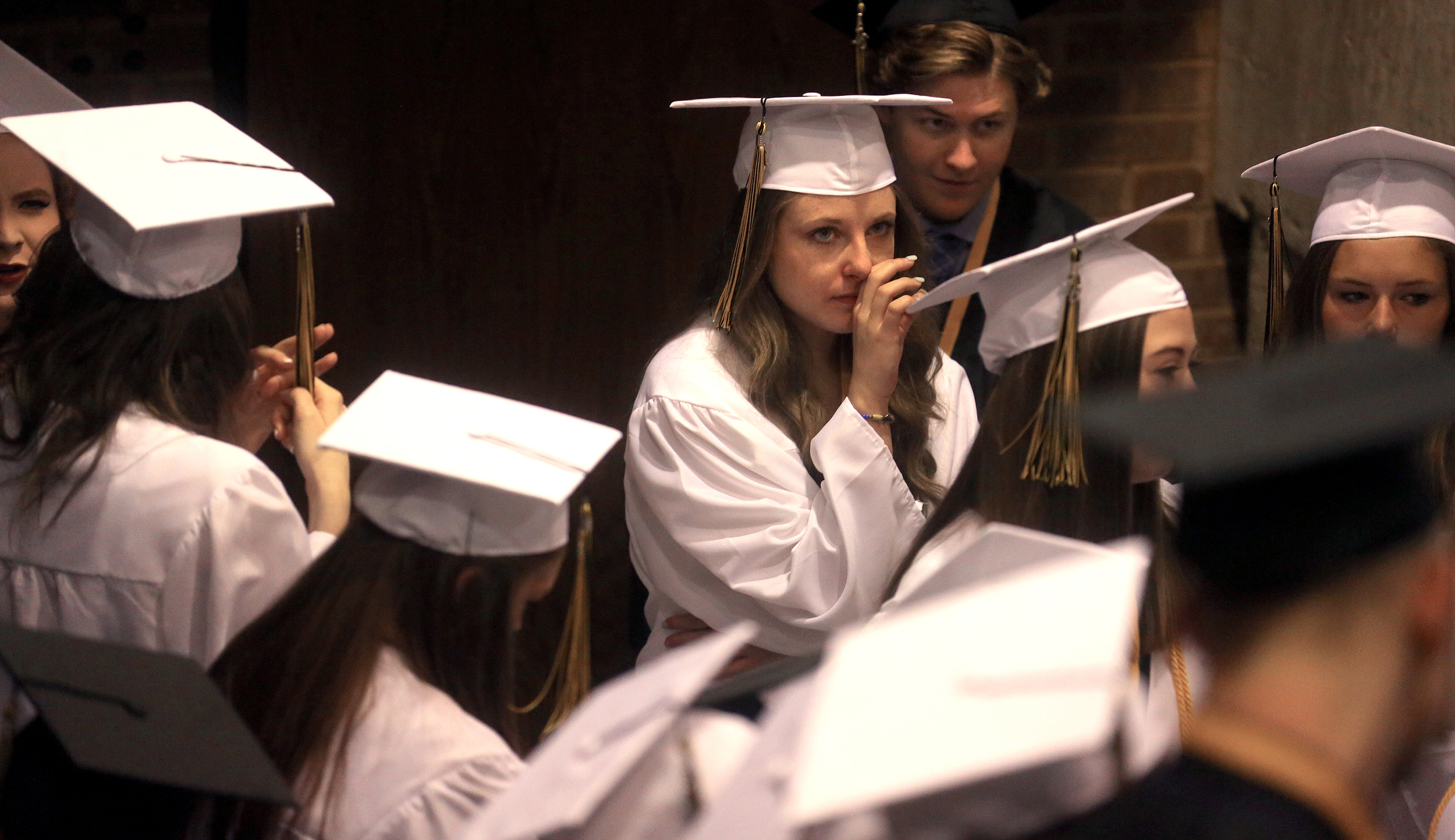 A student had time to reflect before processing with her classmates Sunday. David Spencer/The State Journal-Register