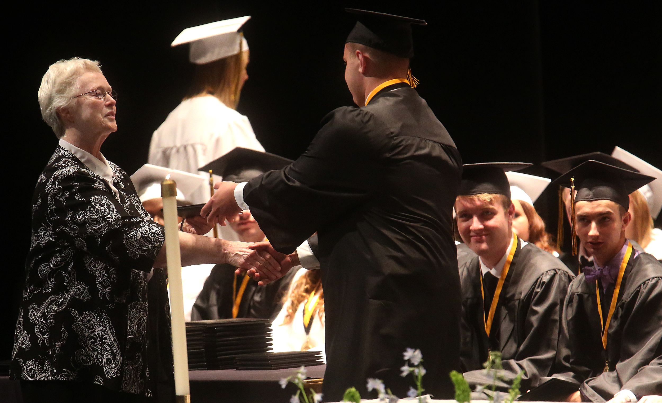 Sister Katherine O'Connor, president of SHG, presented diplomas to graduating students on Sunday. She shared the honor with SHG Principal Sister Margaret Joanne Grueter. David Spencer/The State Journal-Register