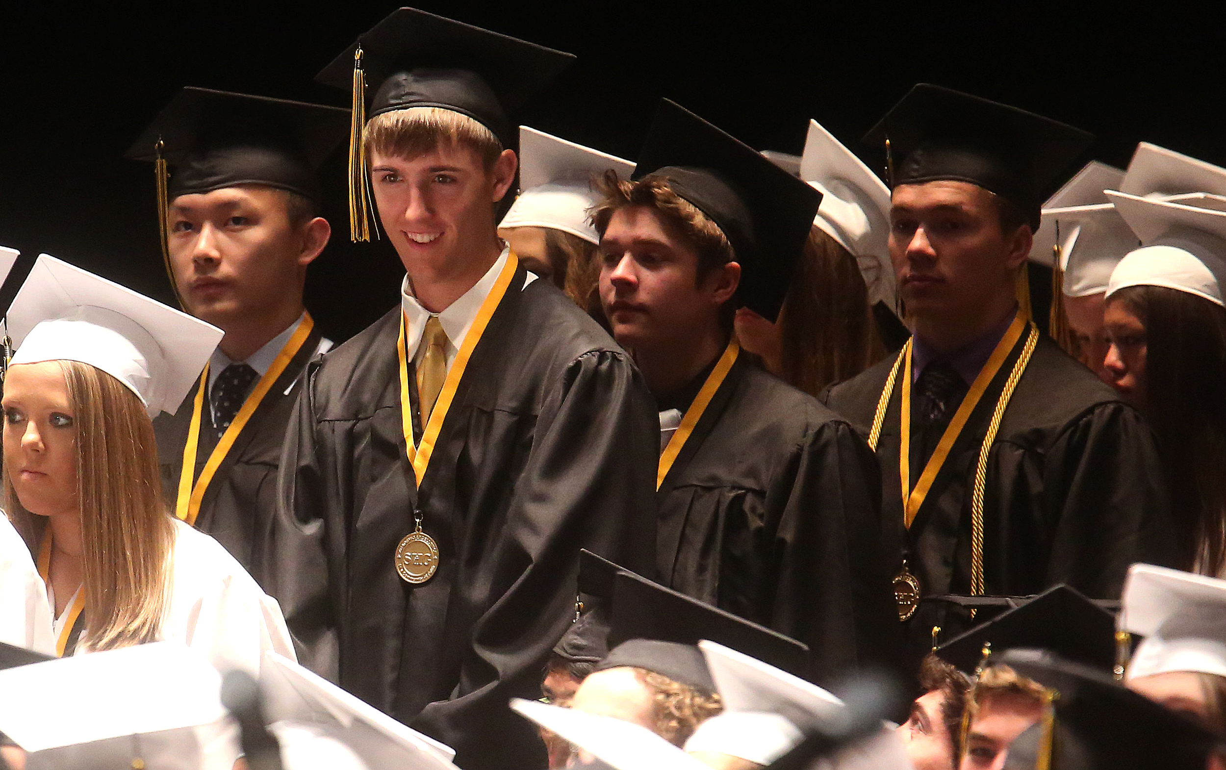 Soon-to-be graduate Jack Staten smiles and waits moments before he received his diploma onstage on Sunday. David Spencer/The State Journal-Register