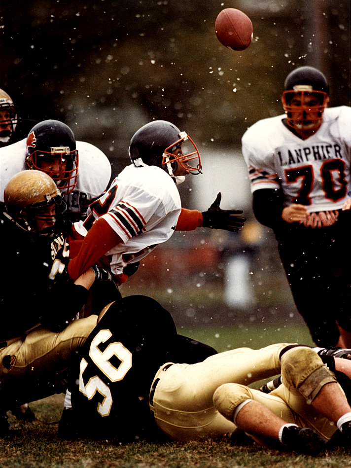 During a November, 1993 Class 4A football playoff game in which Sacred Heart Griffin defeated Lanphier 27-7, Lions intended receiver Aundra Williams looks up at the football after it popped loose during a jarring hit on him by a pair of SHG defenders during first half action. David Spencer/The State Journal-Register