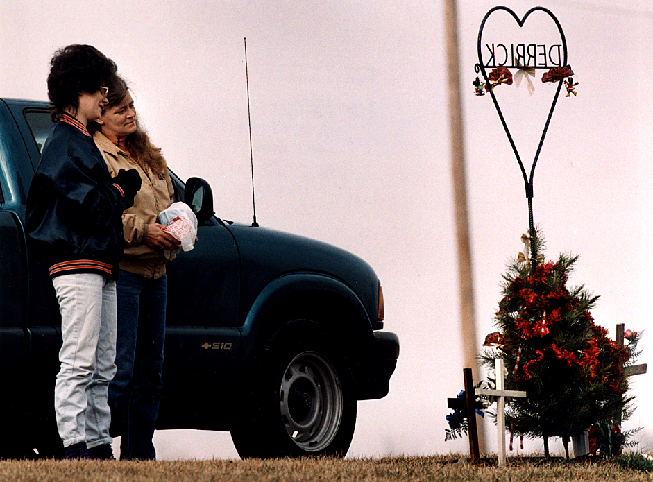 At Virginia's Walnut Ridge Cemetery close to Christmas in 1995, Heather Gebhardt of Beardstown, left, and her mother Diana Ray, reflect at the grave of Gebhardt's son Derrick Lee Gebhardt after they decorated it with a miniature Christmas tree. At the time, Gebhardt said it was her first Christmas without Derrick, who died the previous January after having lived three years with Hydrocephalus. David Spencer/The State Journal-Register
