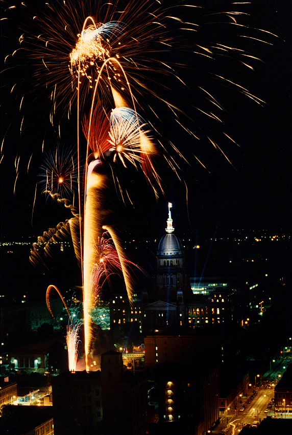 """Shooting from a tripod out windows in July, 1991 atop the Springfield Hilton hotel, I recorded a series of firework bursts in the sky above the state Capitol building during the closing of LincolnFest. The 11th annual installment of the festival, which is no more, attracted 185,000 people. SJR staff writer Sean Noble wrote: """"No matter what the official attendance figure, LincolnFest is no small crowd to manage, and police spokesman Neil Williamson said the city's 84 officers assigned to patrol downtown for the festival kept busy with traffic control, lost children and checking the IDs of young-looking drinkers."""" David Spencer/The State Journal-Register"""