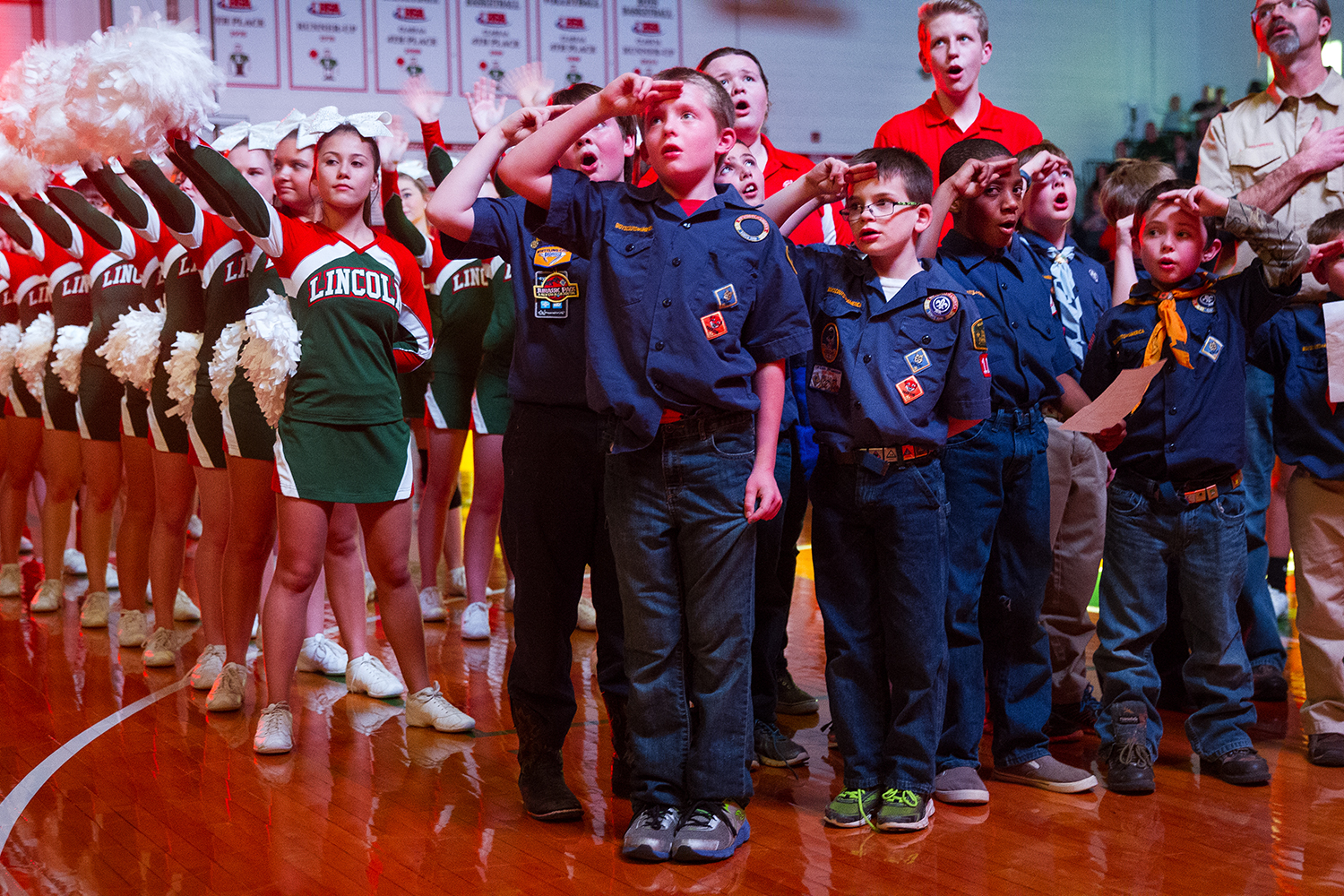 A group of Cub Scouts leads the crowd in the National Anthem before Lincoln faces Lanphier at Lincoln High School Friday, February 10, 2017. Ted Schurter/The State Journal-Register
