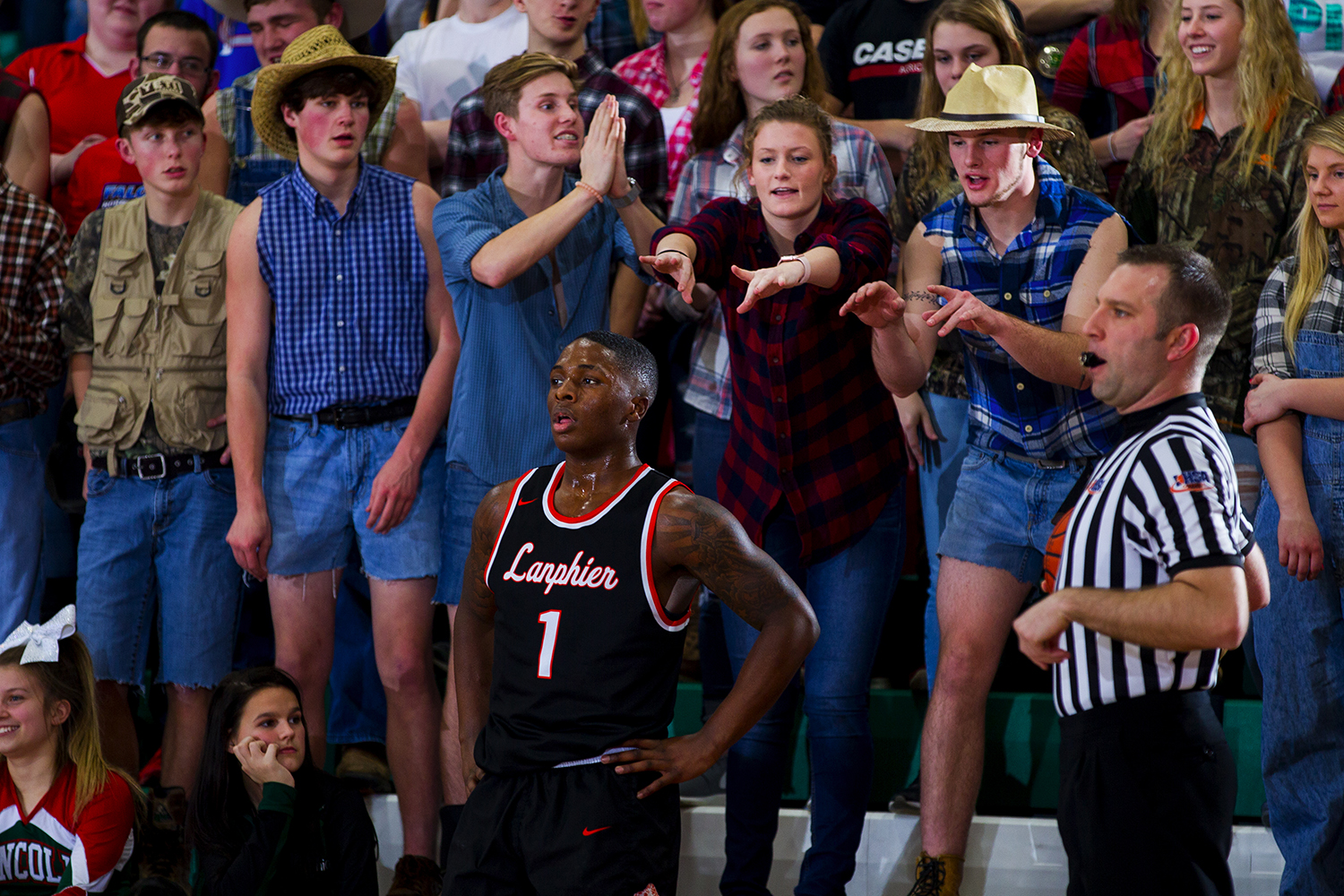 Lincoln fans antagonize Lanphier's Yaakema Rose as he prepares to inbounds the ball at Lincoln High School Friday, February 10, 2017. [Ted Schurter/The State Journal-Register]