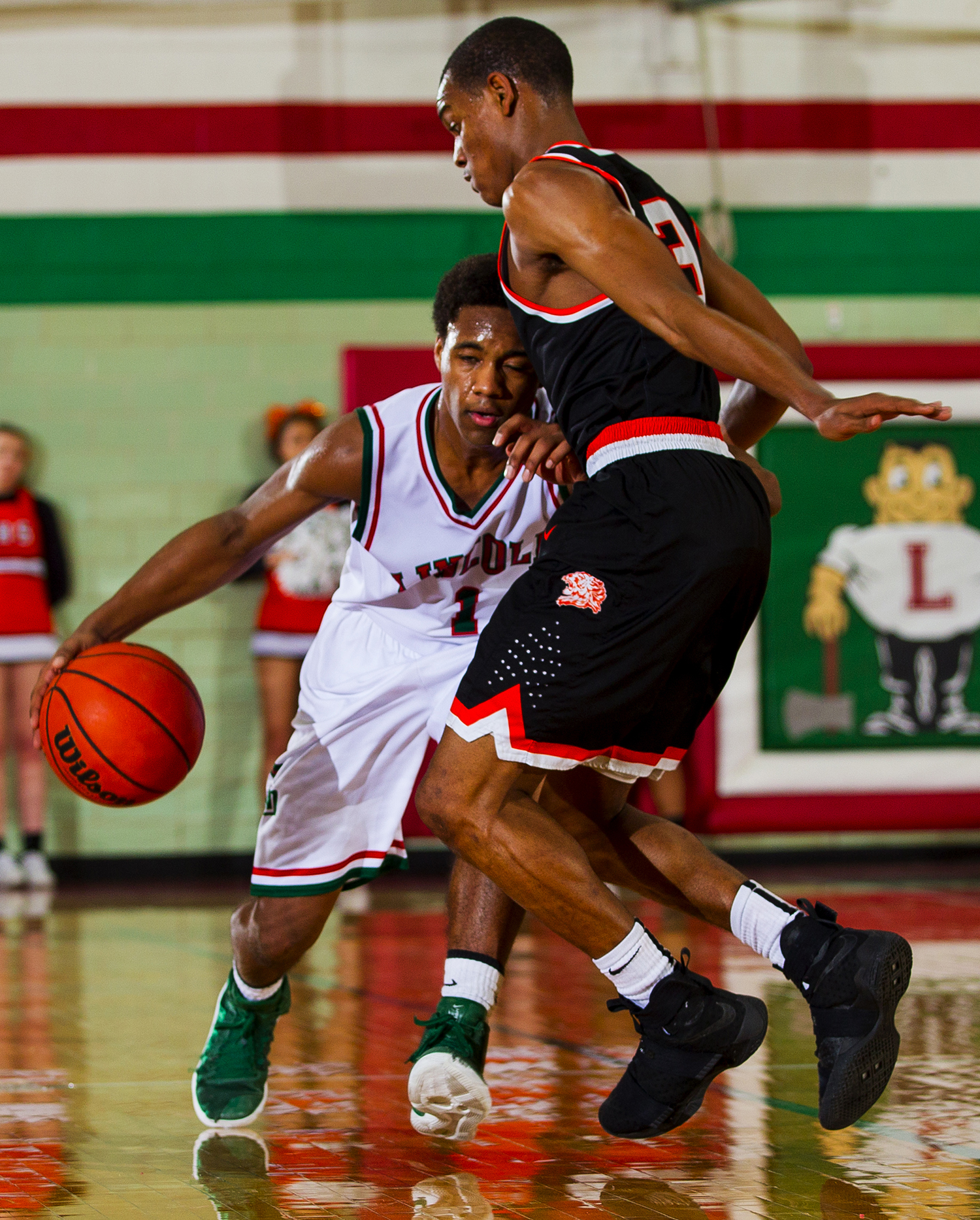 Lincoln's Titus Canon plows into Lanphier's Aundrae Williams at Lincoln High School Friday, February 10, 2017. [Ted Schurter/The State Journal-Register]