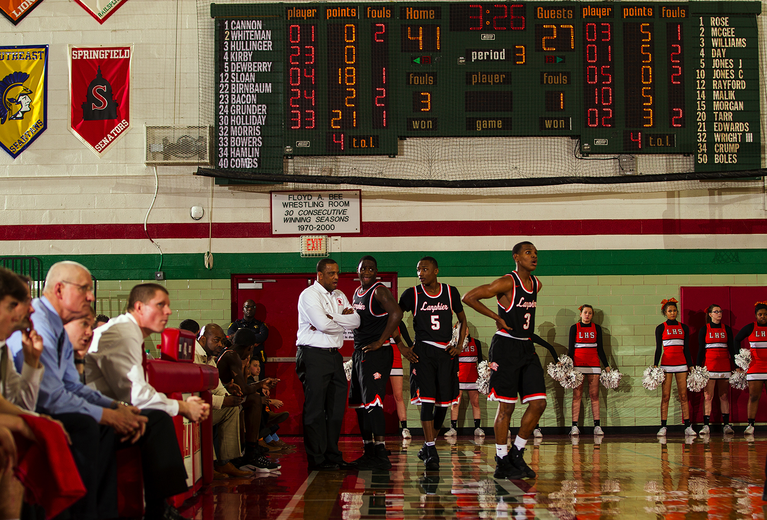 Lanphier head coach Blake Turner talks to his team as they face a steep deficit against Lincoln at Lincoln High School Friday, February 10, 2017. [Ted Schurter/The State Journal-Register]