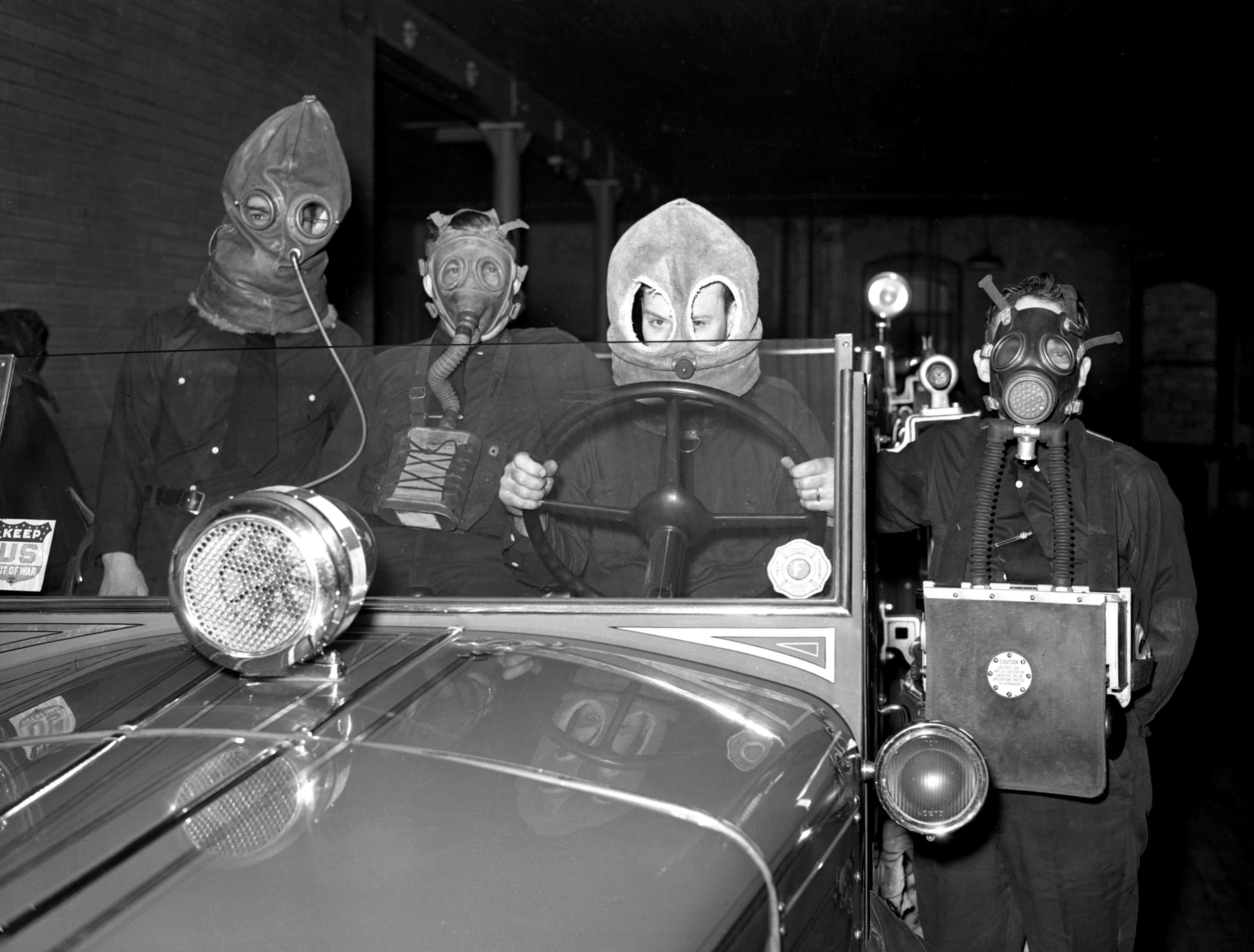 Firemen with masks, March 5, 1940Springfield firefighters demonstrate the evolution of the gas mask. The masks were discovered among old equipment in the city'sNo. 1 engine house and modeled by, from left,  J. W. Franklin,  wearing a 1914 asbestos model, Al Summers with a 1916 leather mask, Clarke Earley with a 1924 filter type and James Hamilton with the new oxygen type.