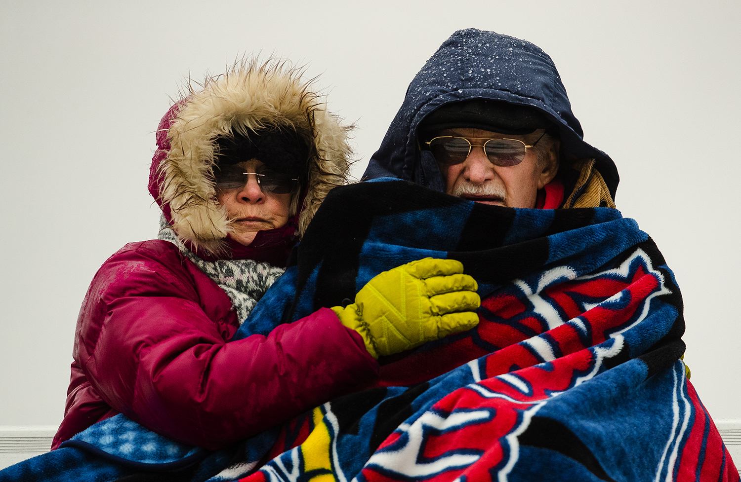 Athens fans bundled up against the cold and rain for the opening kick off of the IHSA Class 1A football semifinal game at the Athens Sports Complex Saturday, Nov. 18, 2017. [Ted Schurter/The State Journal-Register]