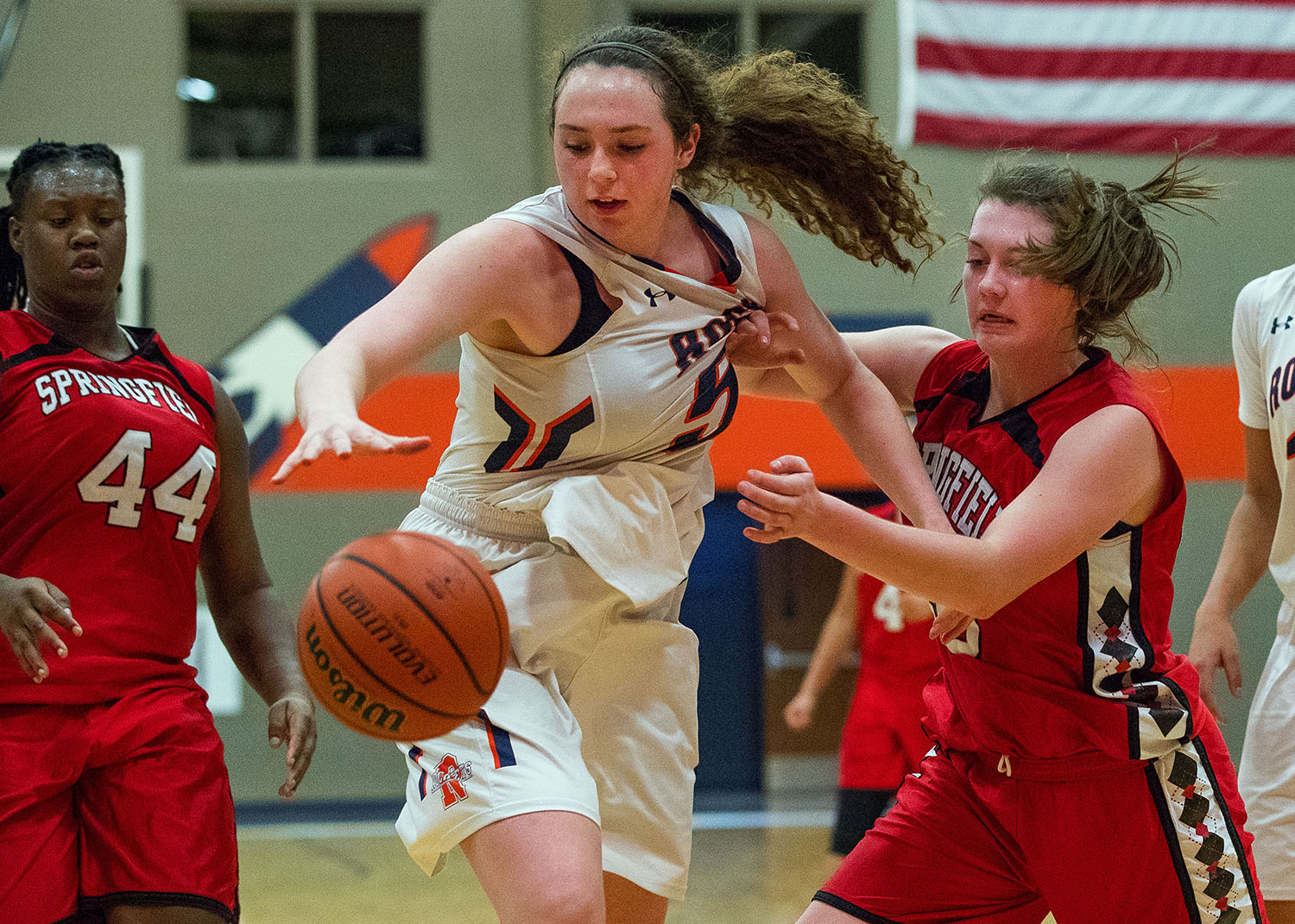 Rochester's Angela Perry and Springfield's Abby Ratsch battle for a rebound at Rochester High School Wednesday, Jan. 18. Ted Schurter/The State Journal-Register