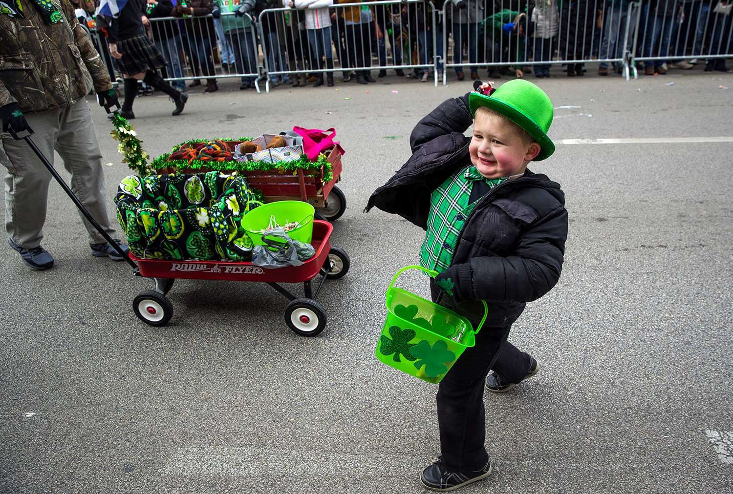Marcin Moody winds up to throw a handful of candy to spectators during the St. Patrick's Day Parade March 11. Moody marched with the St. Andrew's Society of Central Illinois. Ted Schurter/The State Journal-Register