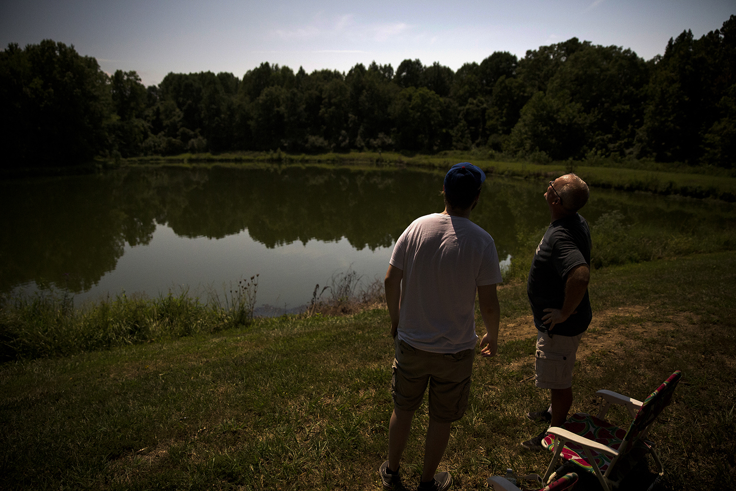 Jimmy Kowalczyk, left, and his dad, Dan, watch the eclipse during complete totality at Giant City State Park near Carbondale Aug. 21. Rich Saal/The State Journal-Register