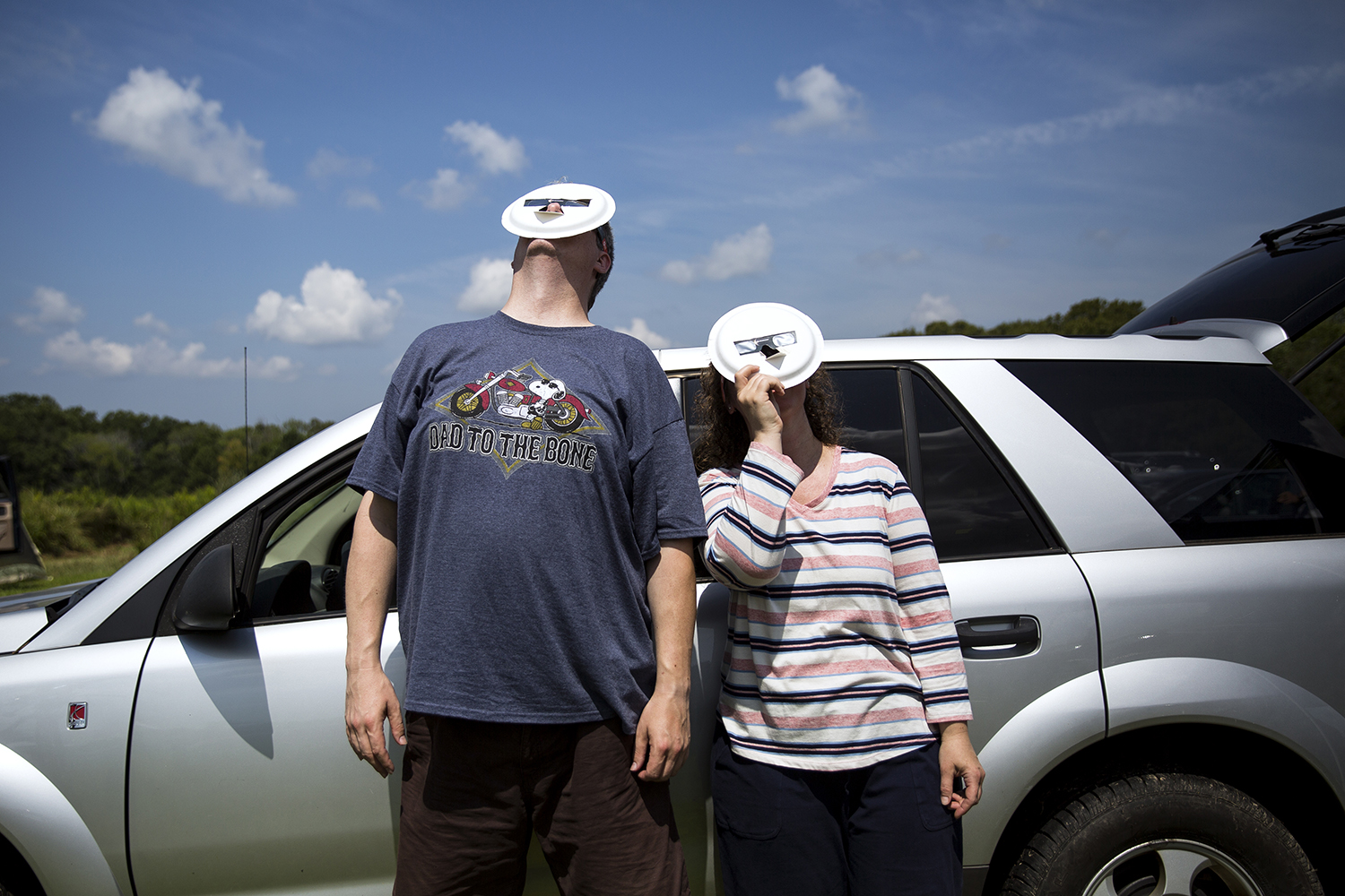 "Tammy and Paul Bronk used adapted eclipse glasses to screen their faces from the sun while viewing the early stages of the total solar eclipse from Giant City State Park near Carbondale Aug. 21. ""It went fast but yet it felt like time stood still. Twilight and still and perfect, it was so beautiful,"" Tammy Bronk said when the eclipse was over. Portions of Southern Illinois near Carbondale experienced the longest duration of totality in the country. Rich Saal/The State Journal-Register"