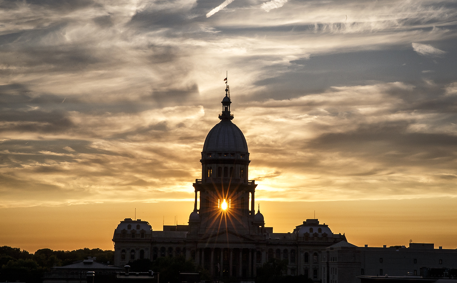 The setting sun is caught shining through the State Capitol dome Sept. 11. Clouds stretching to the west are the remnants of Hurricane Irma. Justin L. Fowler/The State Journal-Register