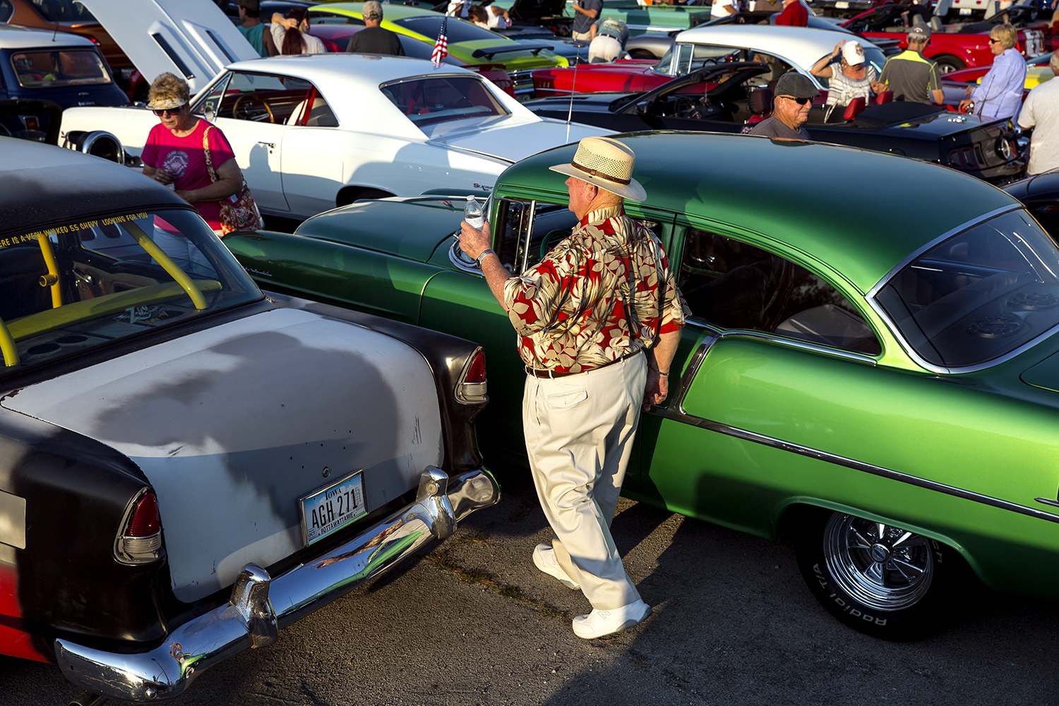 Steve Leach wanders through the cars lined up for the Route 66 City Nights Cruise in the Capital City Shopping Center parking lot Sept. 22. The cruise kicked off the 16th annual Route 66 Mother Road Festival downtown. Rich Saal/The State Journal-Register