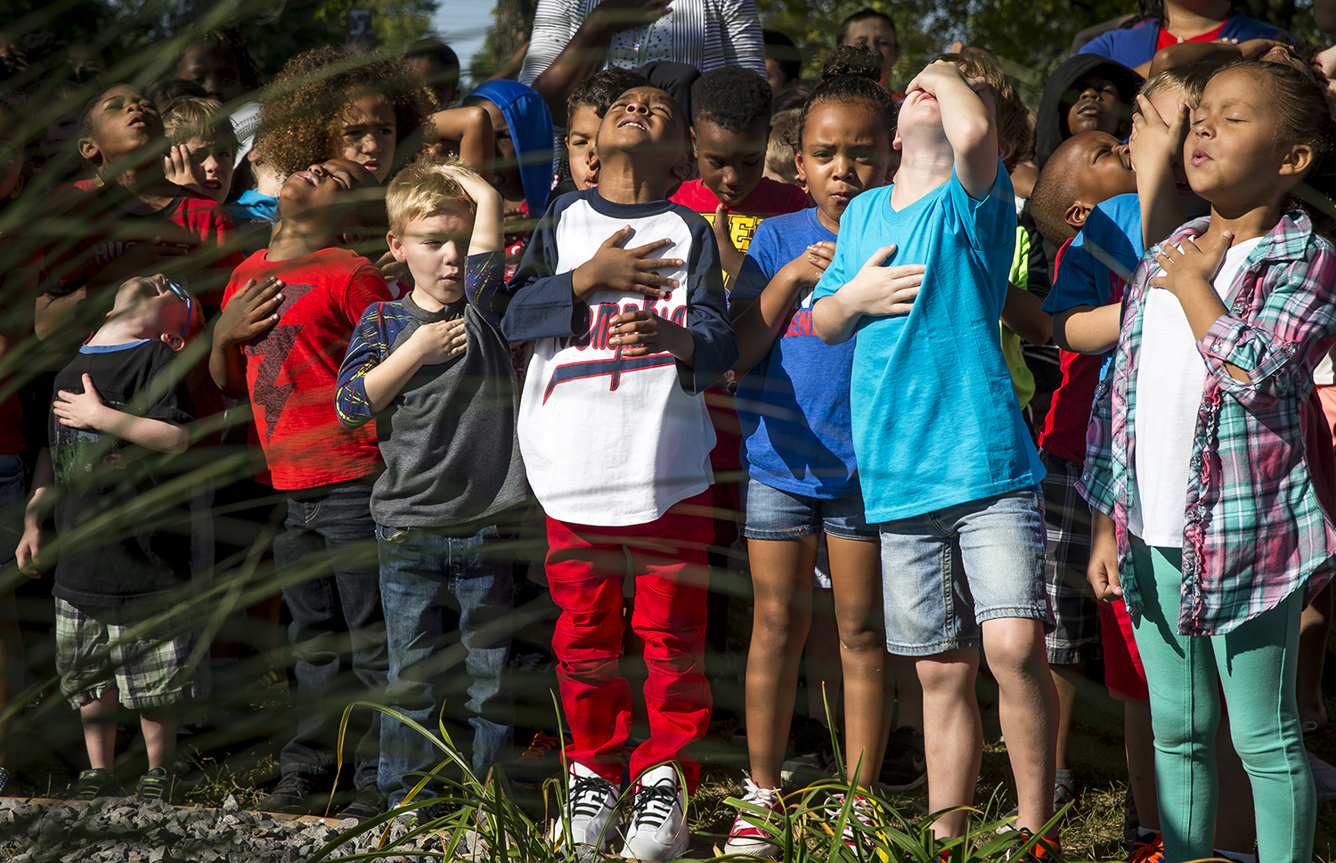 Squinting into the sunlight, Carl Sandburg Elementary students gathered around the school's flagpole, covered their hearts and recited the Pledge of Allegiance during a program to celebrate the 203rd anniversary of the national anthem, Sept. 15. Justin L. Fowler/The State Journal-Register