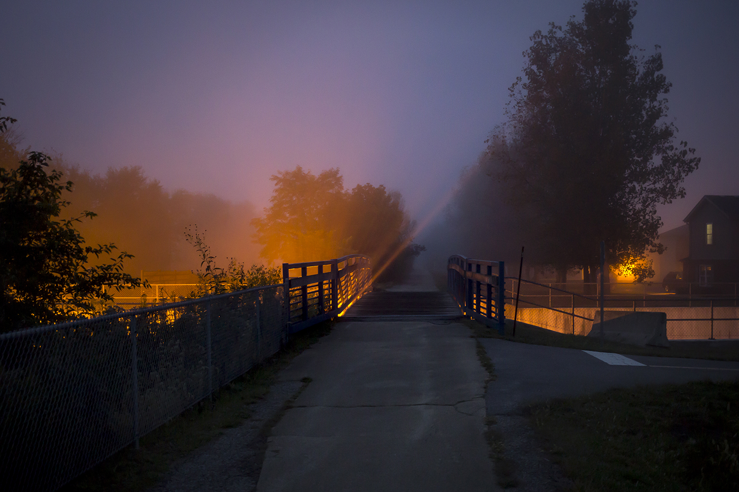 Lights from Plummer Boulevard in Chatham stream through the fog on the Interurban Bike Trail Oct. 9. Rich Saal/The State Journal-Register