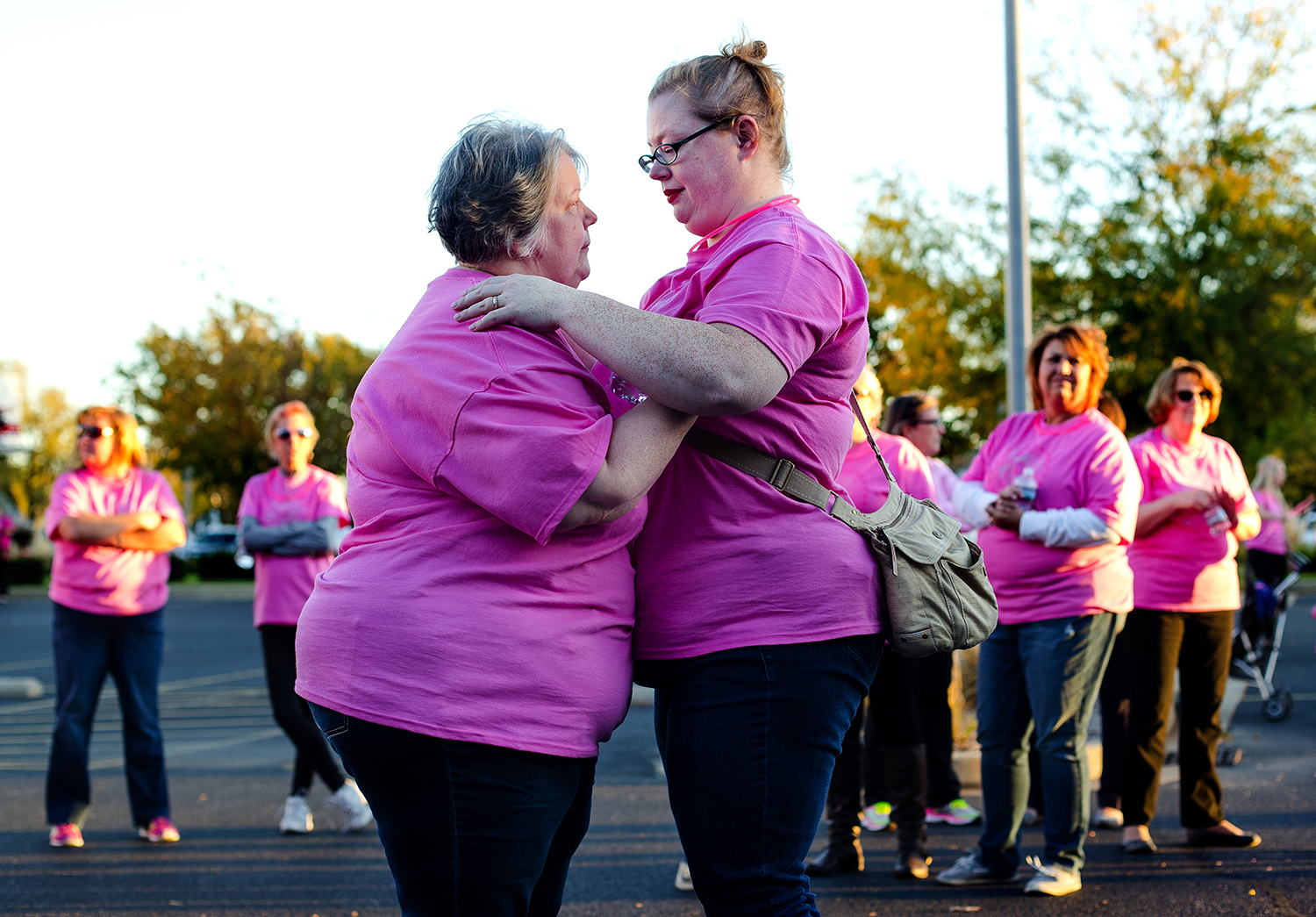 Ea Tucker and her daughter, Katie Schuh, console each other during the Light the Night Pink event at the Simmons Cancer Institute Oct. 18. Tucker said she got emotional remembering her friend, Lucy Kruger, who died after battling breast cancer. Ted Schurter/The State Journal-Register