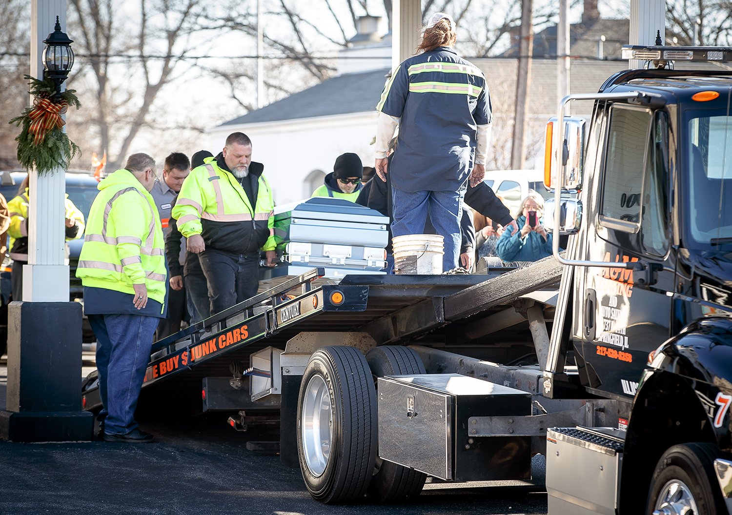 Pallbearers carry the casket of Ron Chaney up the flatbed of a tow-truck from A&M Towing and Salvage Dec. 16 at Kirlin-Egan & Butler Funeral Home. Chaney was struck and killed by a passing motorist on Interstate 72 while he loaded a disabled vehicle. Justin L. Fowler/The State Journal-Register