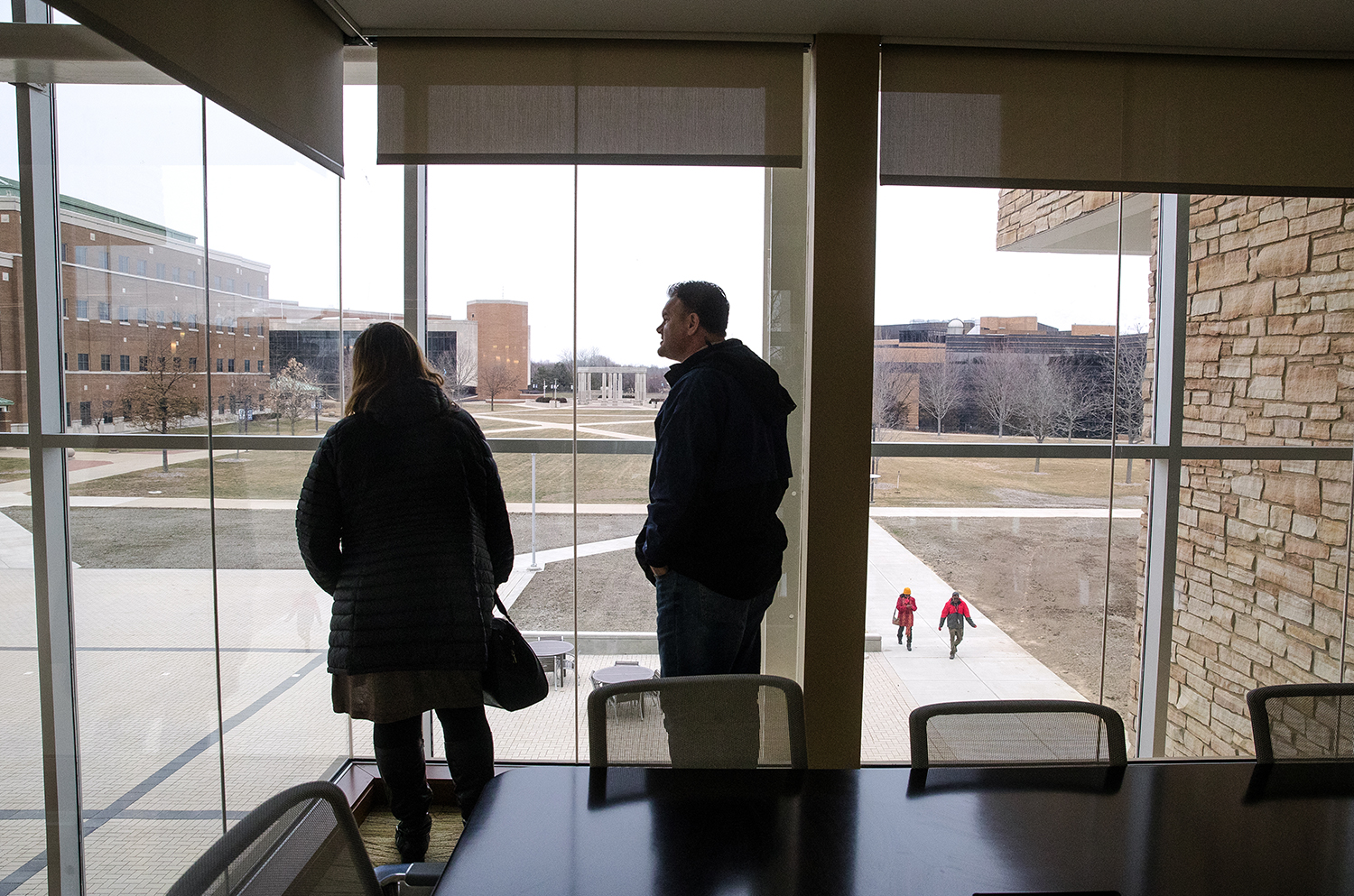 Lisa and Cuneyt Barutcu look north at the rest of the University of Illinois Springfield campus from the George R. and Nancy H. Bunn Family Conference Room during an open house for the new Student Union Sunday, Jan. 14, 2018. [Ted Schurter/The State Journal-Register]