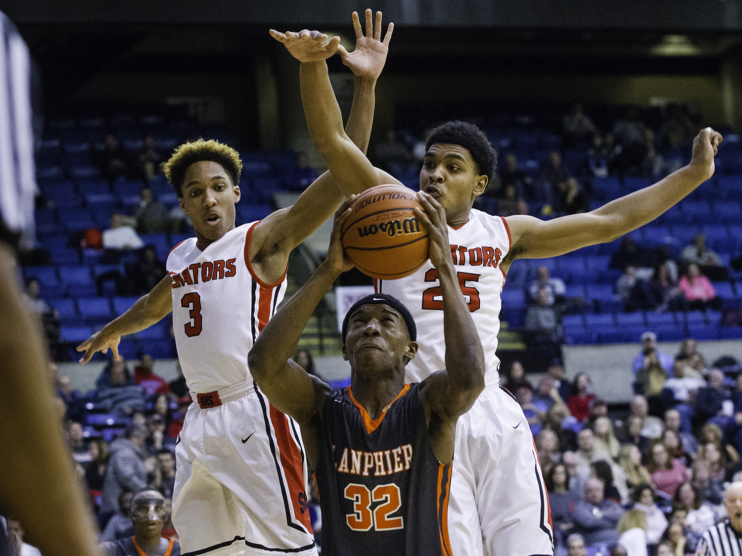 Springfield's Robert Williams, left, and Josh Washington pressure Lanphier's Karl Wright as he drives to the hoop during the Boys City Tournament at the Bank of Springfield Center Thursday, Jan. 18, 2018. [Ted Schurter/The State Journal-Register]