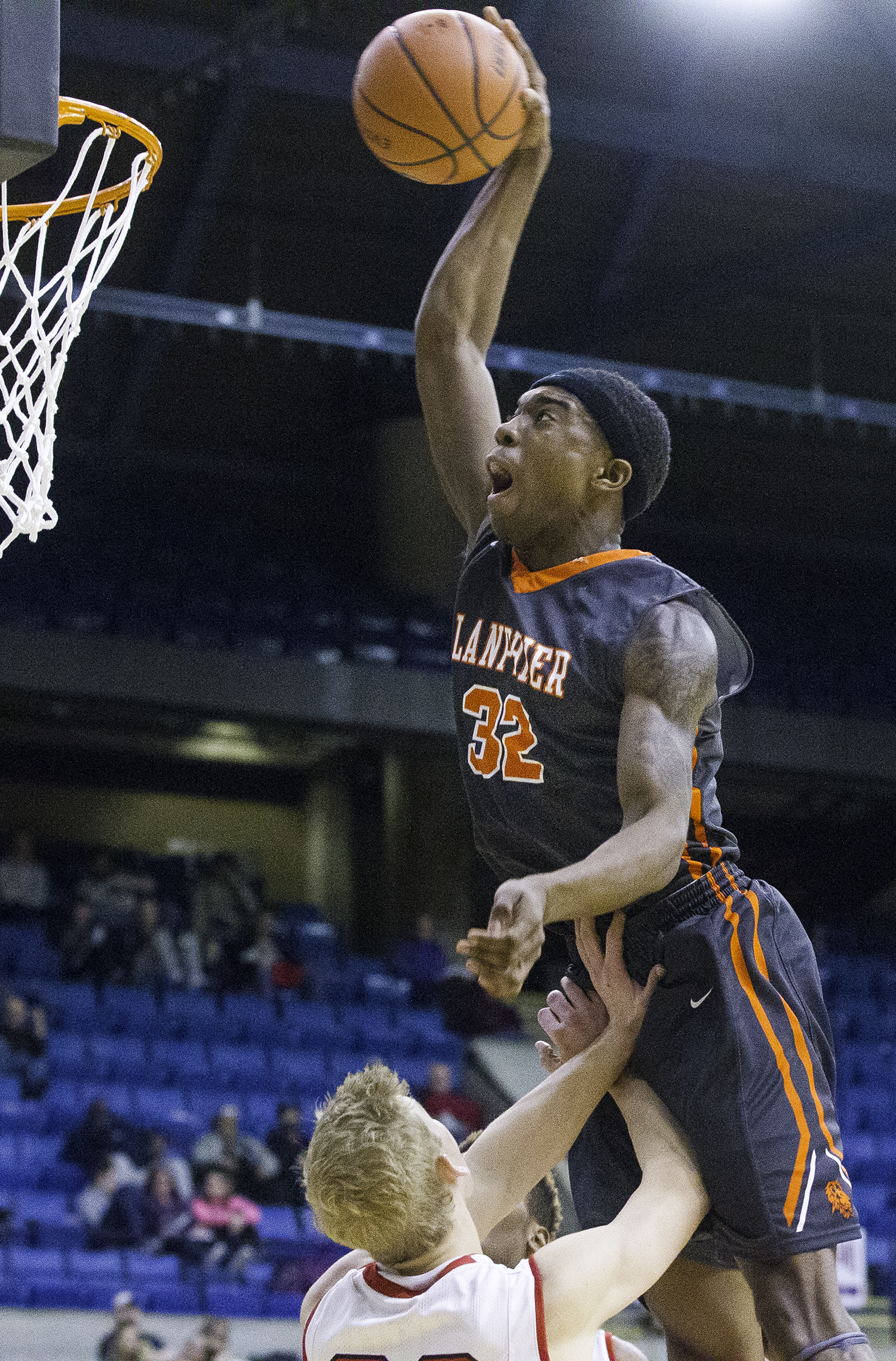 Lanphier's Karl Wright soars in for an attempted dunk against Springfield during the Boys City Tournament at the Bank of Springfield Center Thursday, Jan. 18, 2018. [Ted Schurter/The State Journal-Register]