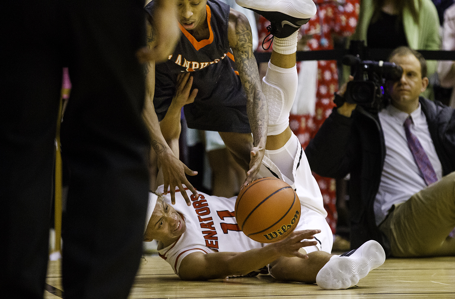 Springfield's Zaire Harris lunges for the ball after getting knocked down by Lanphier's Devione Rayford during the Boys City Tournament at the Bank of Springfield Center Thursday, Jan. 18, 2018. [Ted Schurter/The State Journal-Register]