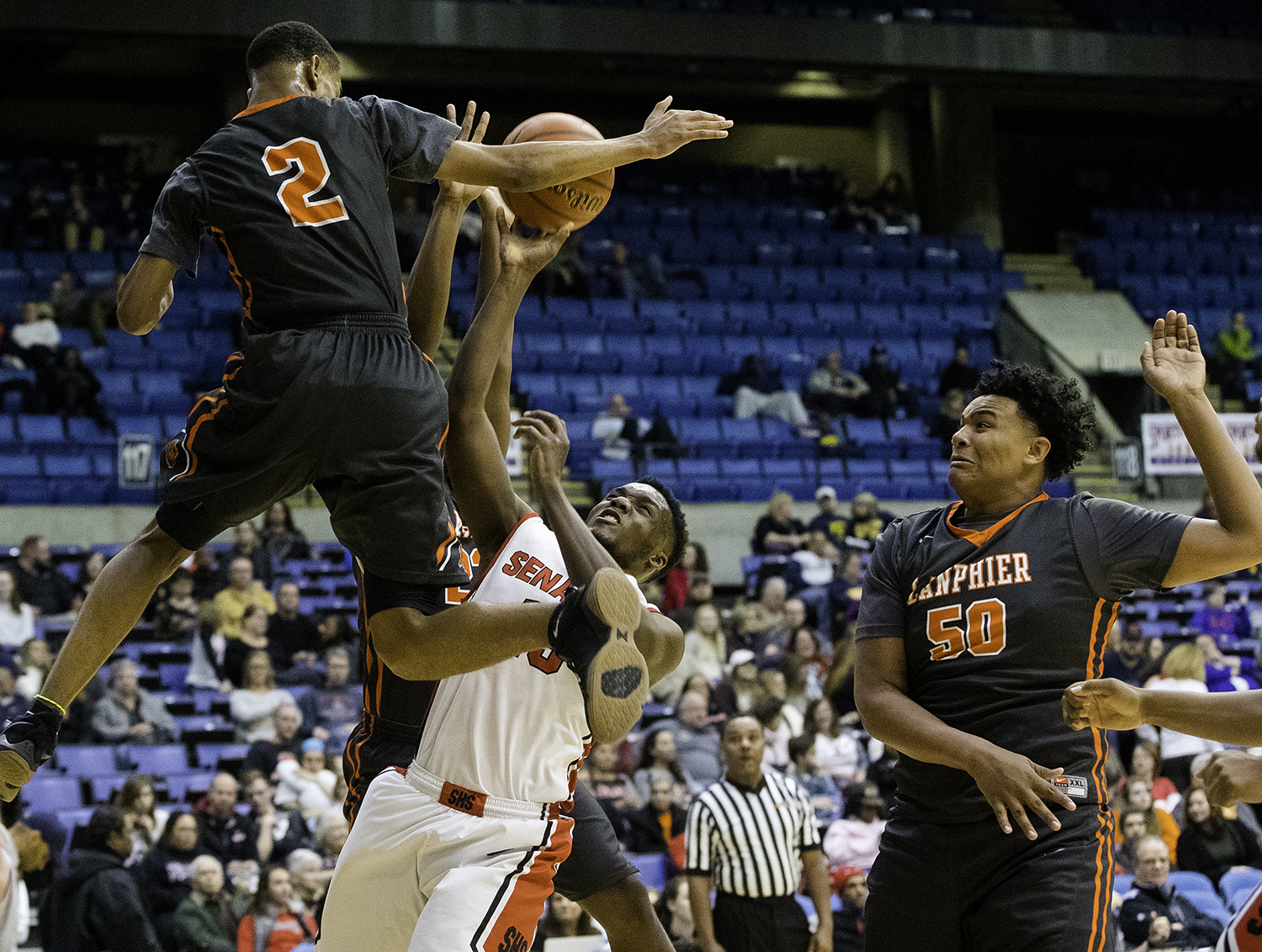 Springfield's Ananise Mackey tries to get a shot off under pressure from Lanphier's Cardell McGee during the Boys City Tournament at the Bank of Springfield Center Thursday, Jan. 18, 2018. [Ted Schurter/The State Journal-Register]