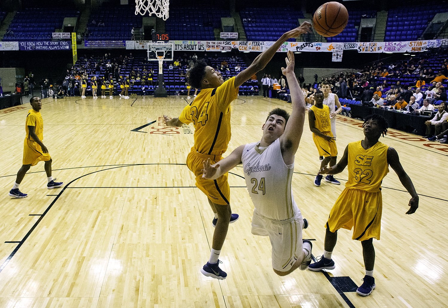 Southeast's Michael Tyler blocks Sacred Heart-Griffin's Nick Broeker as he drives the lane during the Boys City Tournament at the Bank of Springfield Center Thursday, Jan. 18, 2018. [Ted Schurter/The State Journal-Register]