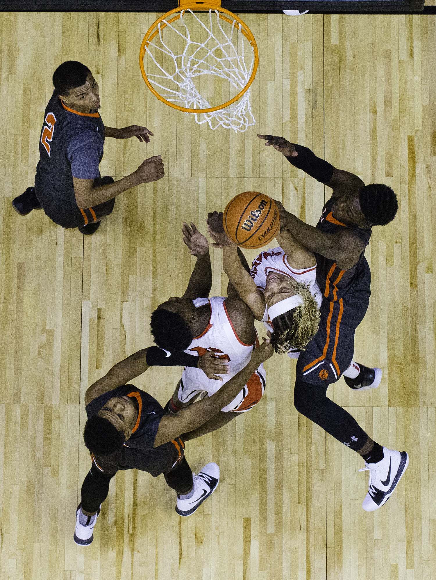 Springfield's Zaire Harris gets squeezed by the Lanphier defense as he drives to the hoop during the Boys City Tournament at the Bank of Springfield Center Thursday, Jan. 18, 2018. [Ted Schurter/The State Journal-Register]