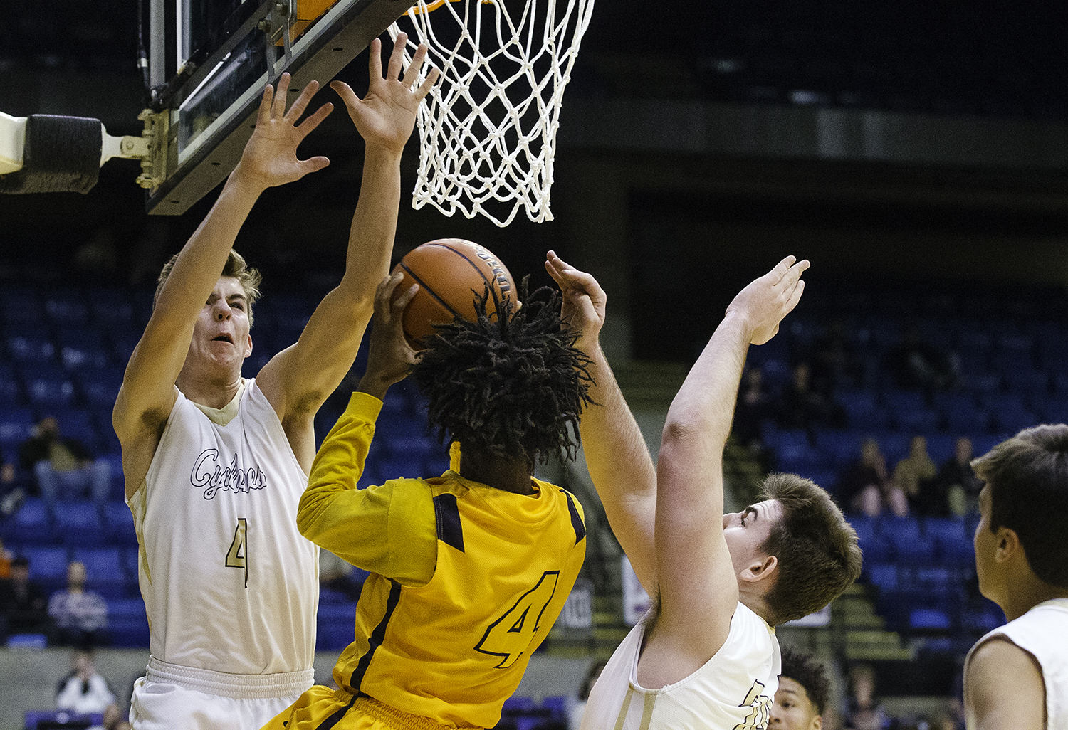 Sacred Heart-Griffin's Charlie Hamilton and Nick Broekerduring pressure Southeast's Terrion Murdix as he takes a shot in the Boys City Tournament at the Bank of Springfield Center Thursday, Jan. 18, 2018. [Ted Schurter/The State Journal-Register]