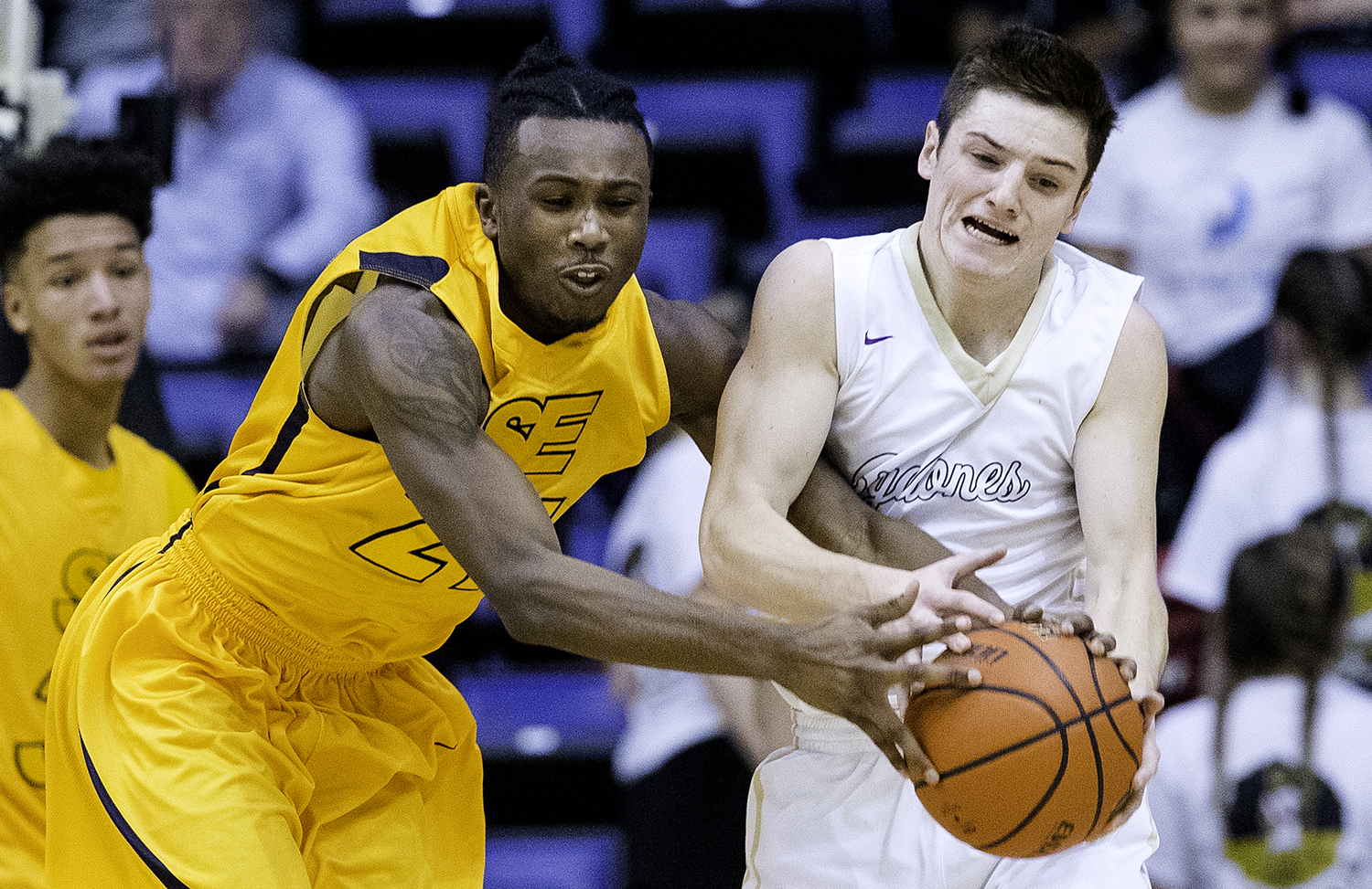 Southeast's Anthony Fairlee and Sacred Heart-Griffin's Evan Warrington fight for a rebound during the Boys City Tournament at the Bank of Springfield Center Thursday, Jan. 18, 2018. [Ted Schurter/The State Journal-Register]