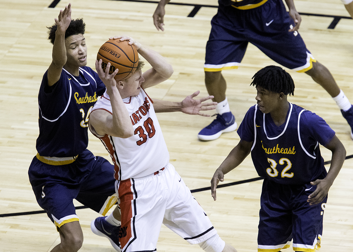 Springfield's Will Reiser looks for help under pressure from Southeast defenders during the Boys City Tournament at the Bank of Springfield Center Friday, Jan. 19, 2018. [Ted Schurter/The State Journal-Register]