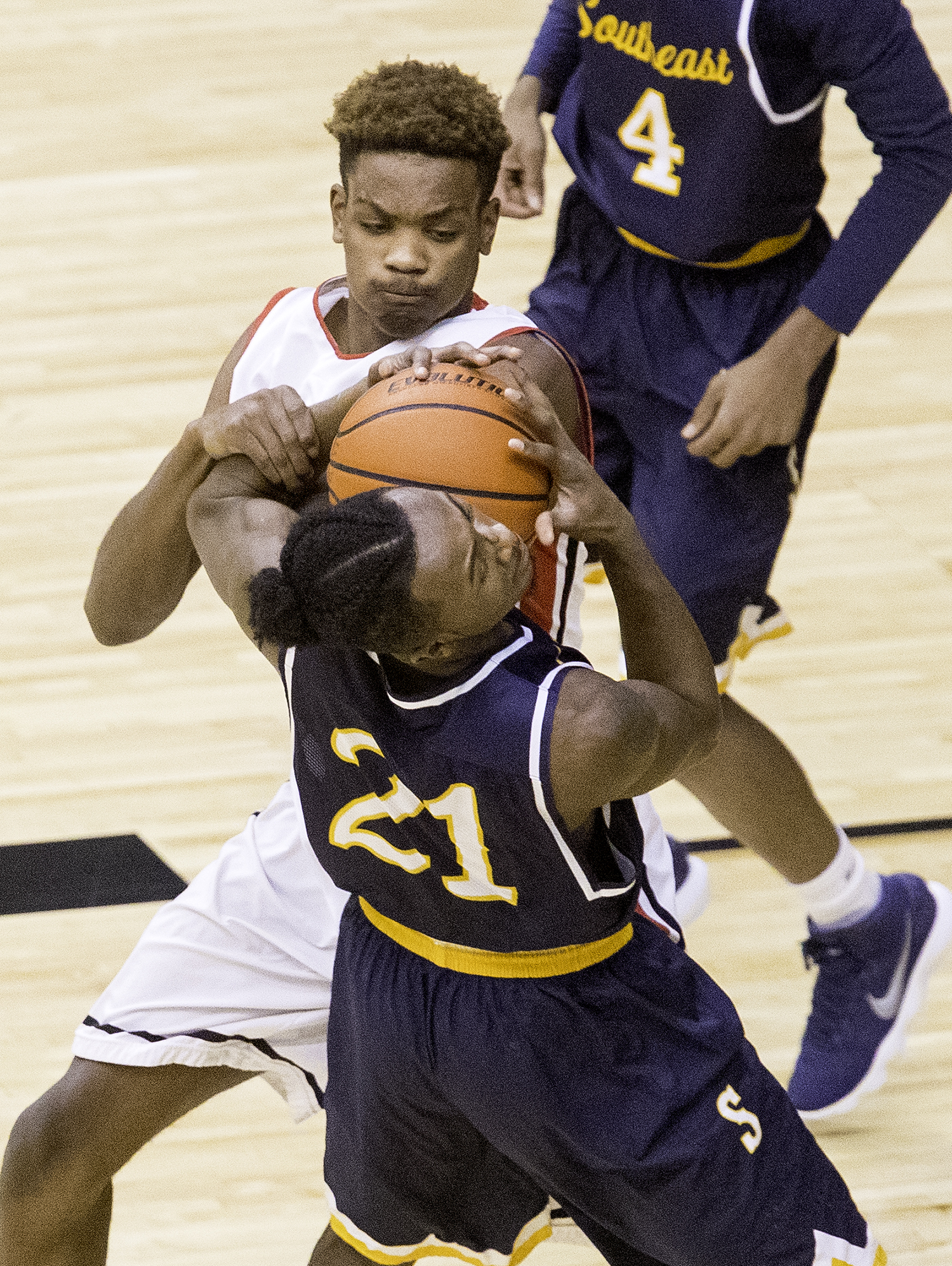 Springfield's Chasten Hughes and Southeast's Anthony Fairlee fight for control of the ball during the Boys City Tournament at the Bank of Springfield Center Friday, Jan. 19, 2018. [Ted Schurter/The State Journal-Register]