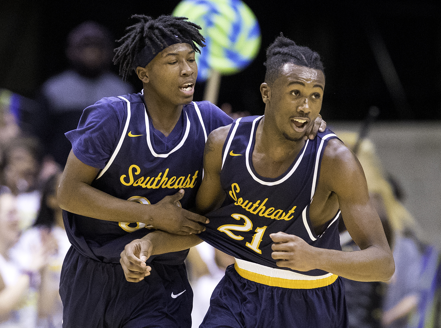 Southeast's Stephens Sims and Anthony Fairlee celebrate as they pull ahead of Springfield in the first half during the Boys City Tournament at the Bank of Springfield Center Friday, Jan. 19, 2018. [Ted Schurter/The State Journal-Register]