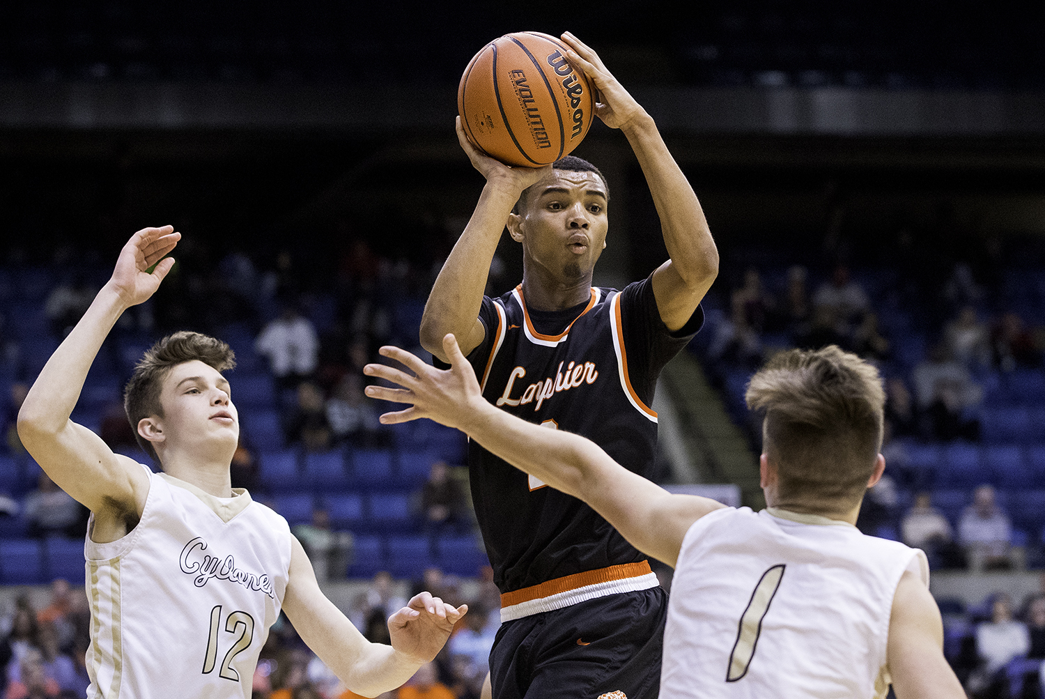Lanphier's Cardell McGee fires a pass around Sacred Heart-Griffin's Max Heinzel during the Boys City Tournament at the Bank of Springfield Center Friday, Jan. 19, 2018. [Ted Schurter/The State Journal-Register]