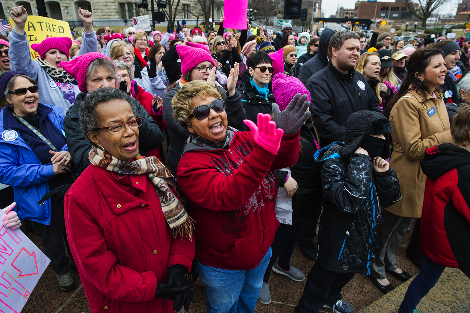 Gwendolyn Lackland, left, and Pamela King cheer for the speakers during the Action Illinois Springfield 'Women's March to the Polls' rally and march in Springfield, Ill., Saturday, Jan. 20, 2018. [Ted Schurter/The State Journal-Register]