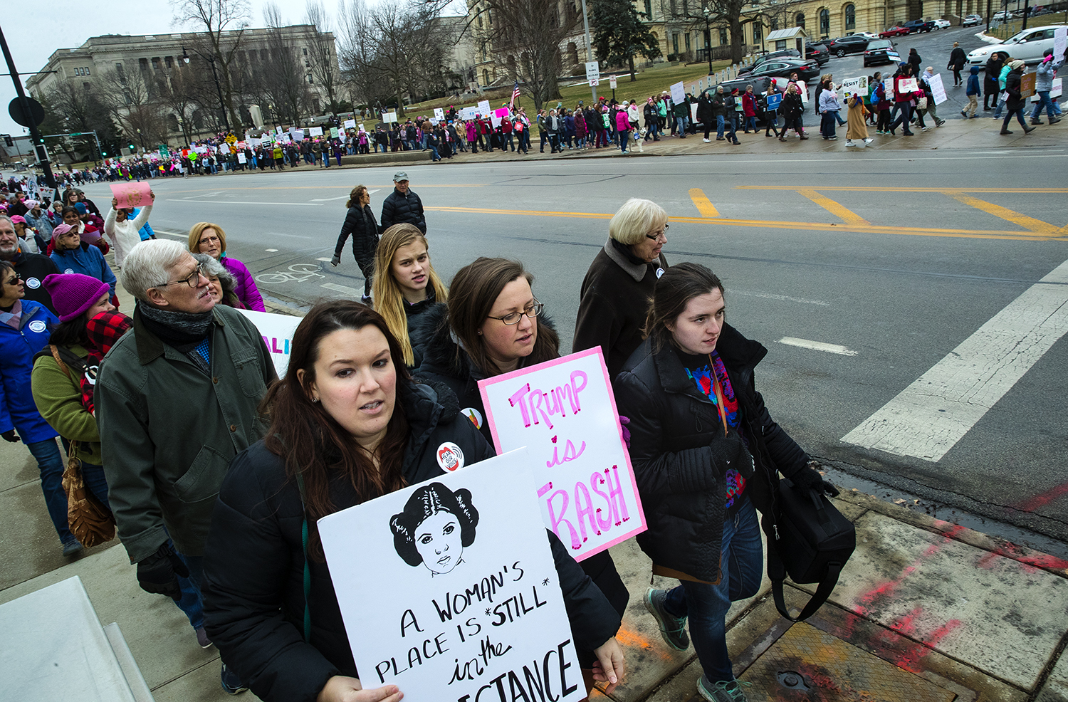 Crowds march down the sidewalks on both sides of Second Street as they travel from the Lincoln Statue at the Illinois Capitol to the Old State Capitol plaza  during the Action Illinois Springfield 'Women's March to the Polls' rally and march in Springfield, Ill., Saturday, Jan. 20, 2018. [Ted Schurter/The State Journal-Register]