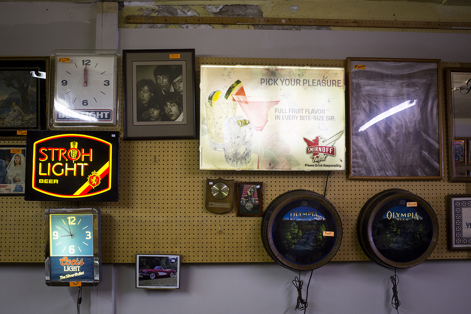 Beer signs and other paraphernalia for sale are displayed in the upstairs record section at Recycled Records Thursday. [Rich Saal/The State Journal-Register]