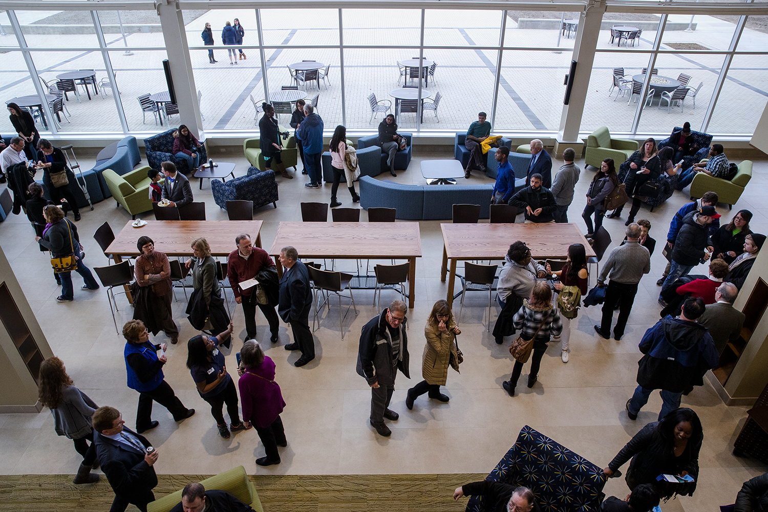 Guests mill about in the lobby of the new $21.75 million Student Union Sunday, Jan. 14, 2018. [Ted Schurter/The State Journal-Register]