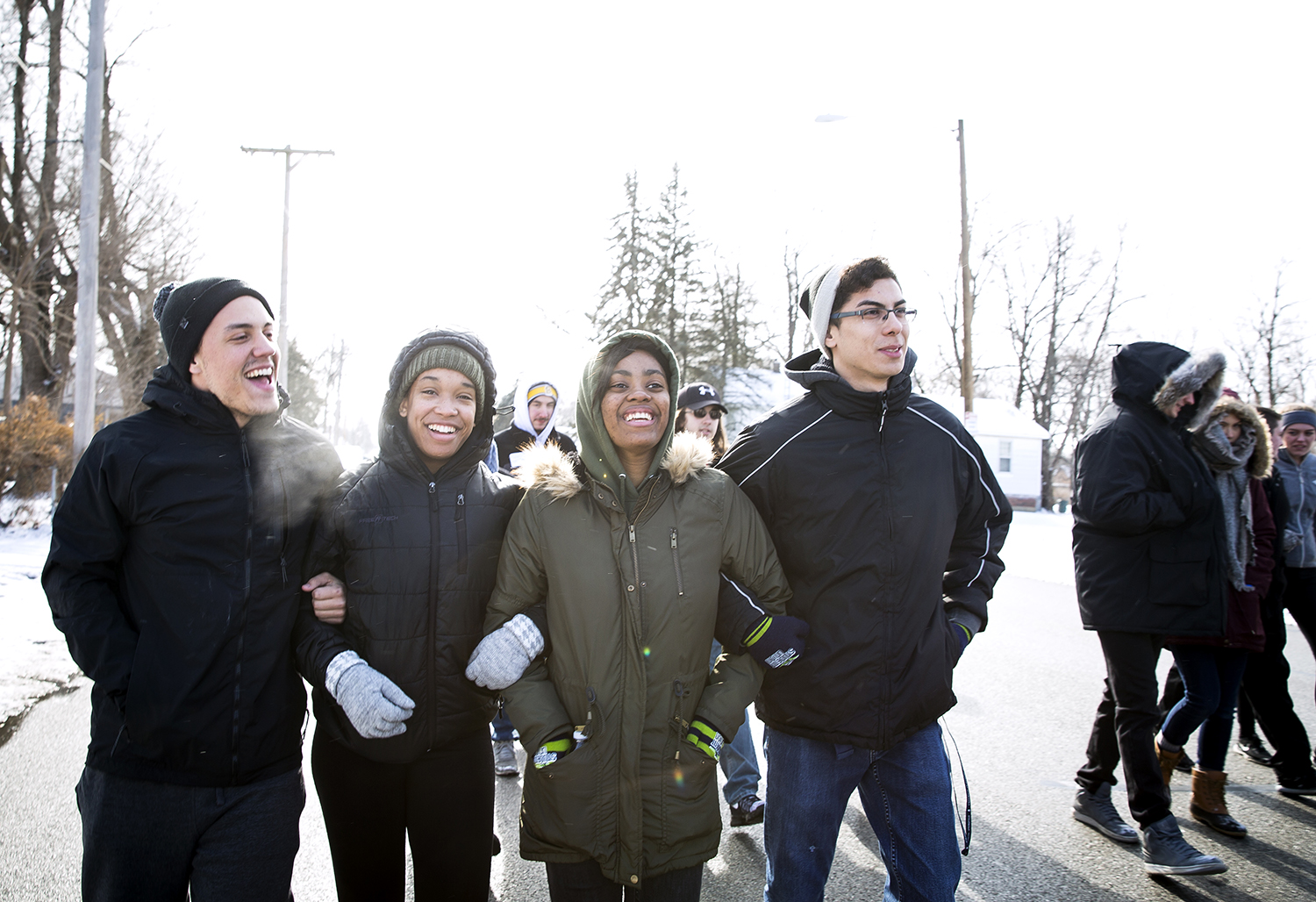 Ben Paoletti, left, Jocelyn Nelson, Erishon Williams and Eric Loera, all students at the University of Illinois Springfield, walk in the Martin Luther King Jr. Unity March Monday, Jan. 15, 2018 on Martin Luther King Drive in Springfield, Ill. The march is sponsored by the Springfield NAACP [Rich Saal/The State Journal-Register]
