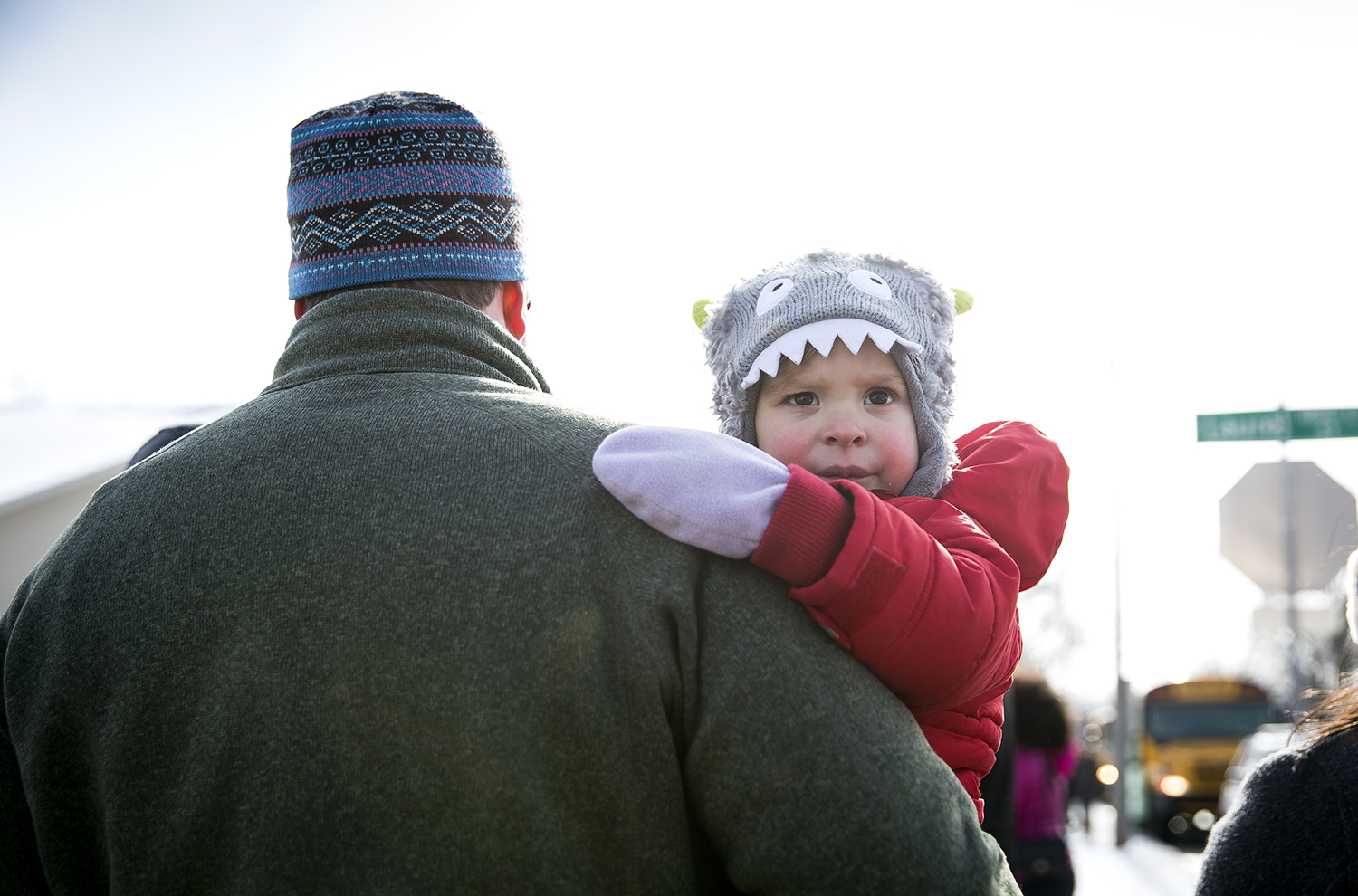 Pierson Coll, 2,who was participating in the Martin Luther King Jr. Unity March Monday, Jan. 15, 2018 with his father, Albert Coll, peers over his dad's shoulders at the starting point of the march at Pilgrim's Rest Baptist Church at Laurel and Martin Luther King Drive in Springfield, Ill. [Rich Saal/The State Journal-Register]