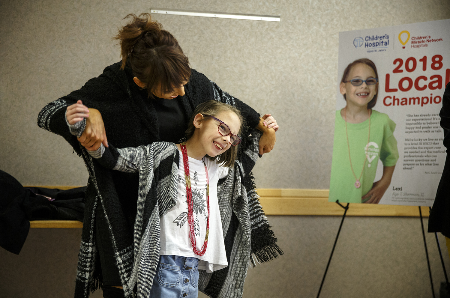 Lexi Sonneborn, 8, gets excited with her mother, Beth Sonneborn, as she is named the 2018 Children's Miracle Network local champion child for HSHS St. John's Children's Hospital during a ceremony, Thursday, Jan. 18, 2018, in Springfield, Ill. In 2017 Lexi had a New Year's Resolution to collect and donate 2000 toys for children having to stay in the hospital like she had and she accomplished her goal donating them to patients at HSHS St. JohnÕs ChildrenÕs Hospital. Lexi's prognosis is extremely positive despite being born prematurely at only 27 weeks gestation in 2009 with cerebral palsy, hydrocephalus, vision problems, developmental delays, cerebellar hypoplasia and seizures. She spent the first three months of her life in the neonatal intensive care unit at the hospital. [Justin L. Fowler/The State Journal-Register]
