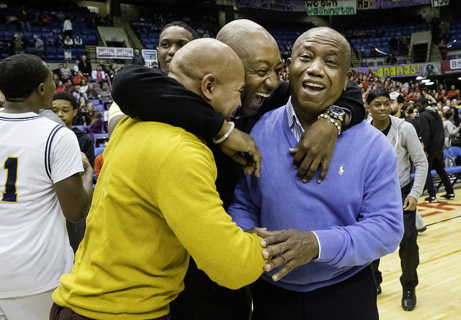 Former assistant Southeast coach Larry Hale and current assistant Chuck Shanklin congratulate Southeast head coach Lawrence Thomas after the Spartans defeated Lanphier during the Boys City Tournament championship at the Bank of Springfield Center Saturday, Jan. 20, 2018. [Ted Schurter/The State Journal-Register]