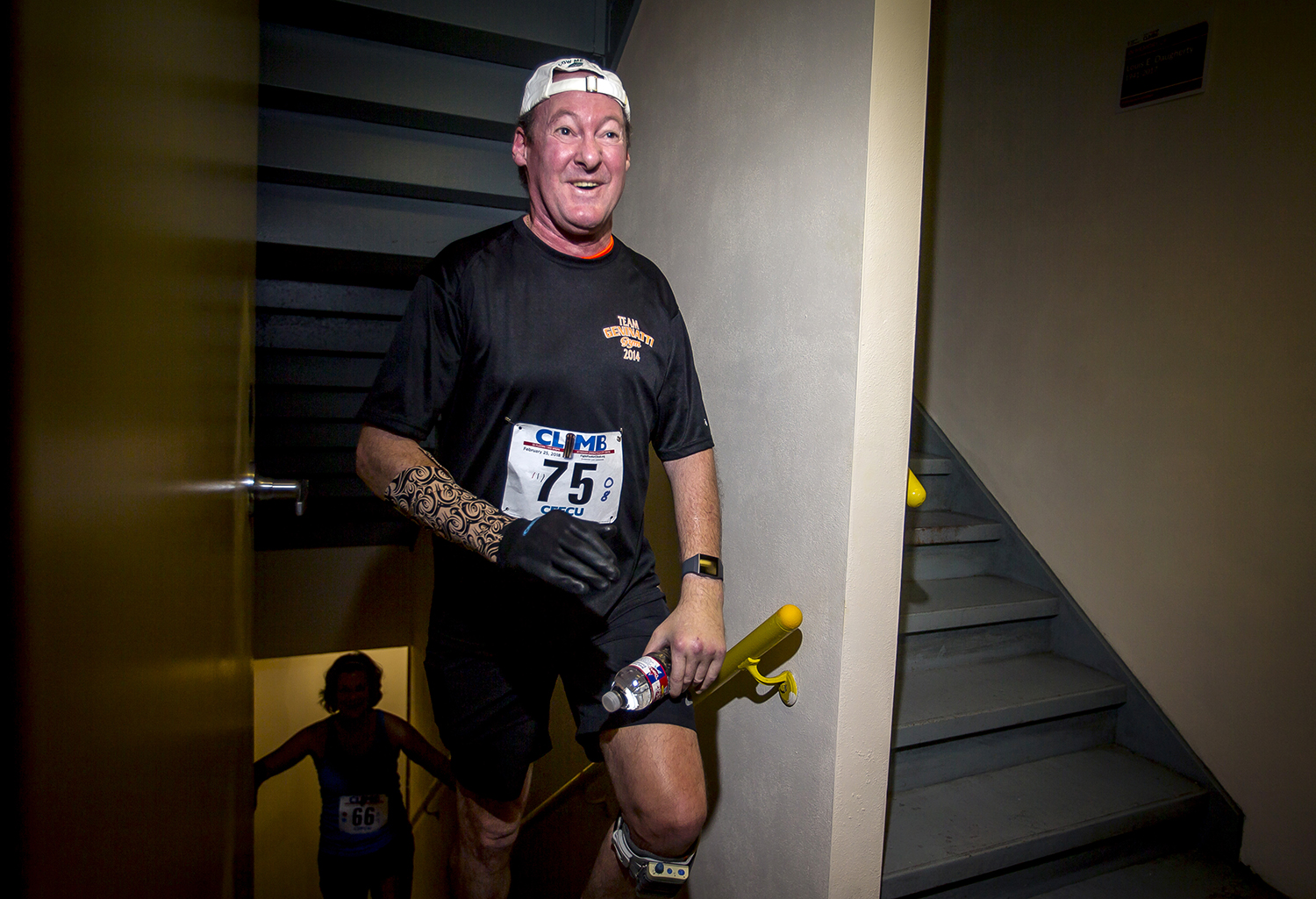 """Mark Block, of Des Moines, Iowa, thanks volunteers and medical staff as they sing """"Lean On Me"""" as he climbs to the 24th floor on his fourth trip as an Ultimate Climber during the American Lung Association Fight For Air Climb at the  Wyndham Springfield City Centre, Sunday, Feb. 25, 2018, in Springfield, Ill. Block is classified as an ambulating quadriplegic after suffering two different accidents in his life that left him paralyzed and after completing the climb for the fourth time was returning to climb again for his team. """"You have so many people on any given day that tell you what you can't do and what you shouldn't do or you might get hurt,"""" said Block. """"Just to come here among like minded people and it's all about what you can do, we all help each other to the top."""" [Justin L. Fowler/The State Journal-Register]"""