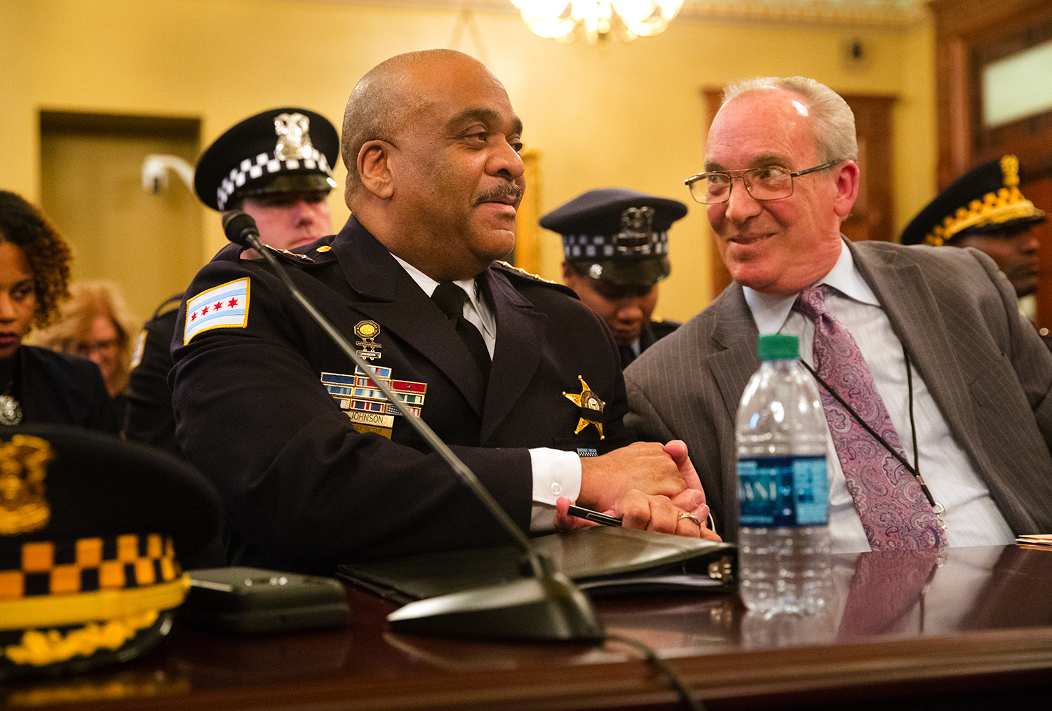 Chicago Police Superintendent Eddie Johnson shakes hands with Rep. Daniel J. Burke, D-Chicago, after new gun legislation, part of which is written and named in honor of slain 18th District Commander Paul Bauer, passed a committee Tuesday, Feb. 27, 2018. The proposed legislation seeks to ban extended gun magazines and the sale of body armor and increases penalties for civilian use of ballistic body armor. [Ted Schurter/The State Journal-Register]